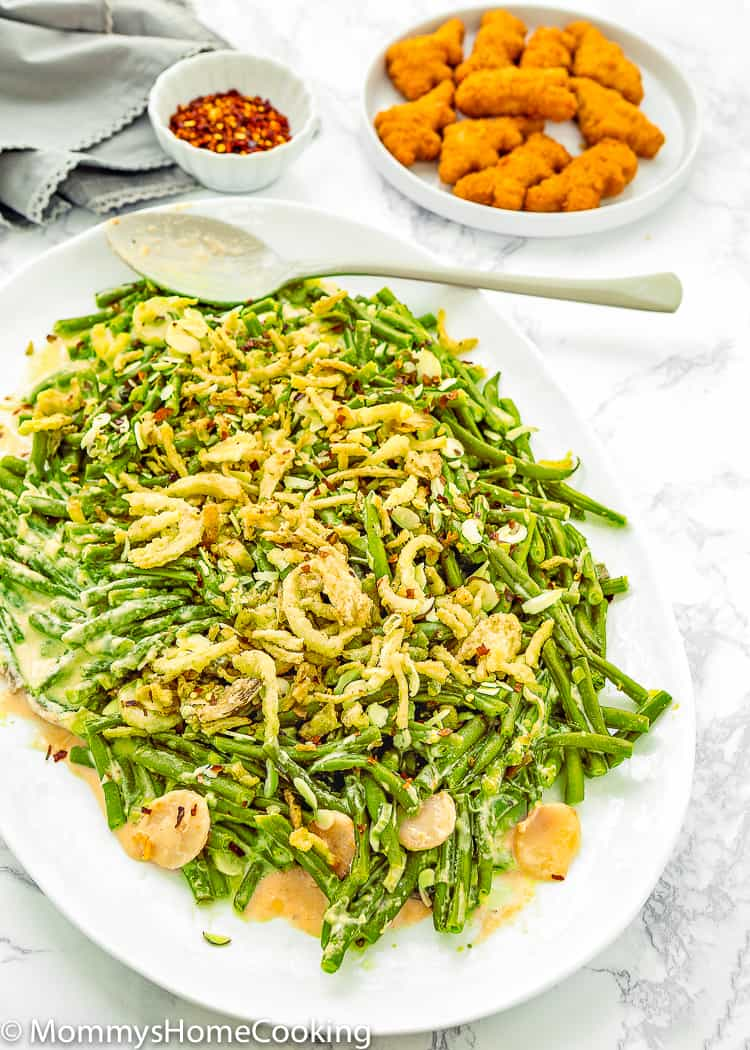 This Slow Cooker Easy Green Beans Casserole is a delicious way for the family to love their veggies! It's creamy, cheesy and absolutely delicious. Perfect as a holiday side dish, as well as any busy weeknight. https://mommyshomecooking.com
