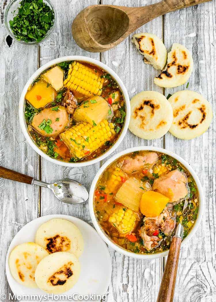 2 bowls with Venezuelan Oxtail Soup and arepas