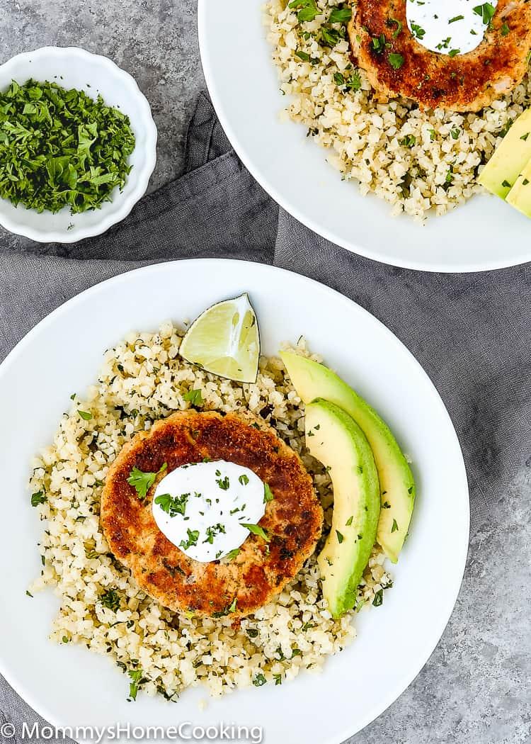 2 plates with Eggless Salmon Patties, Cauliflower rice and avocado.