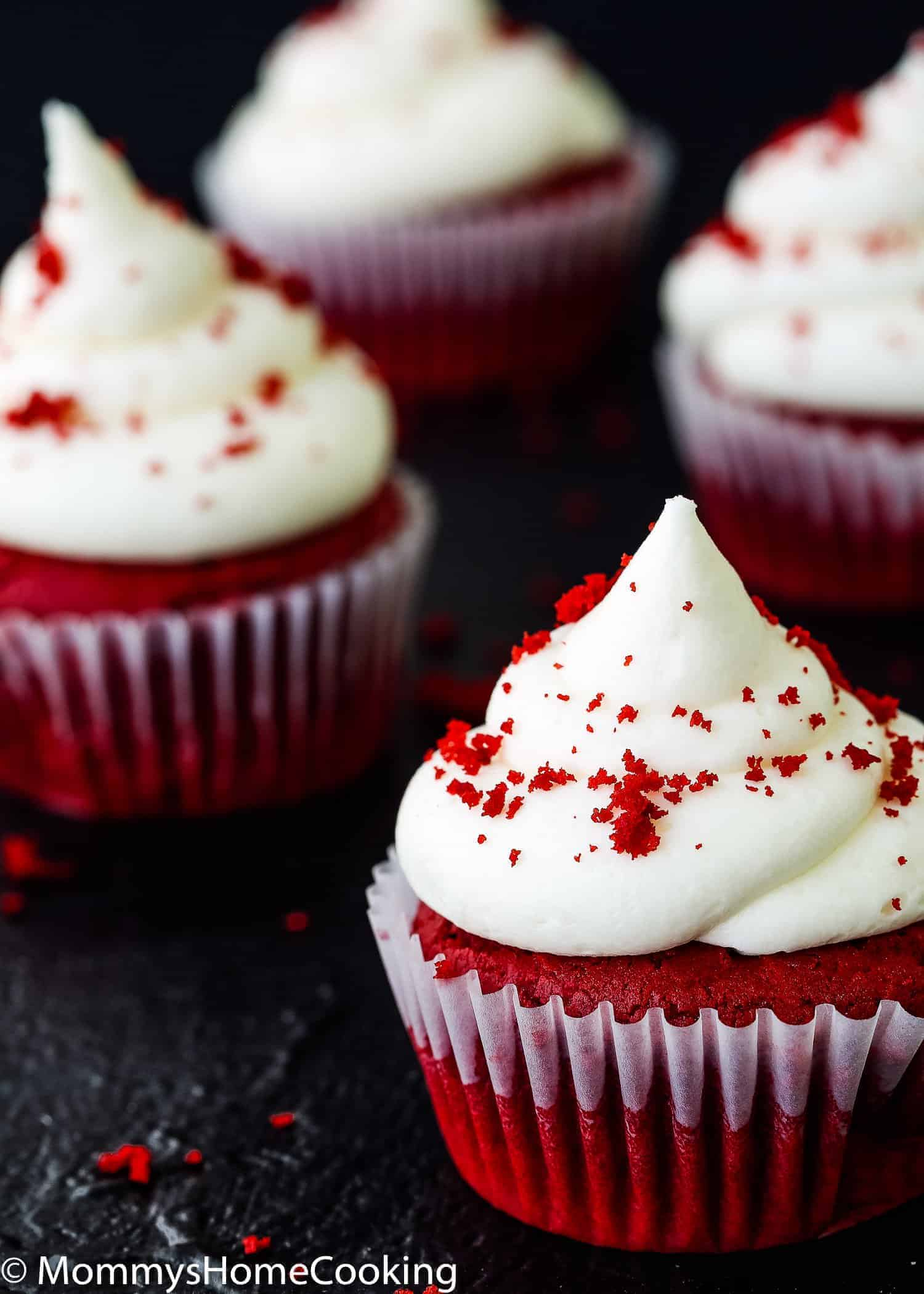 These Easy Eggless Red Velvet Cupcakes are tender, light, moist and delicious all at once!! They are super easy to whip up for your next get-together. Perfect for crowded birthday parties and school celebrations. https://mommyshomecooking.com