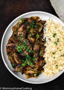 liver and onion with white rice in a plate