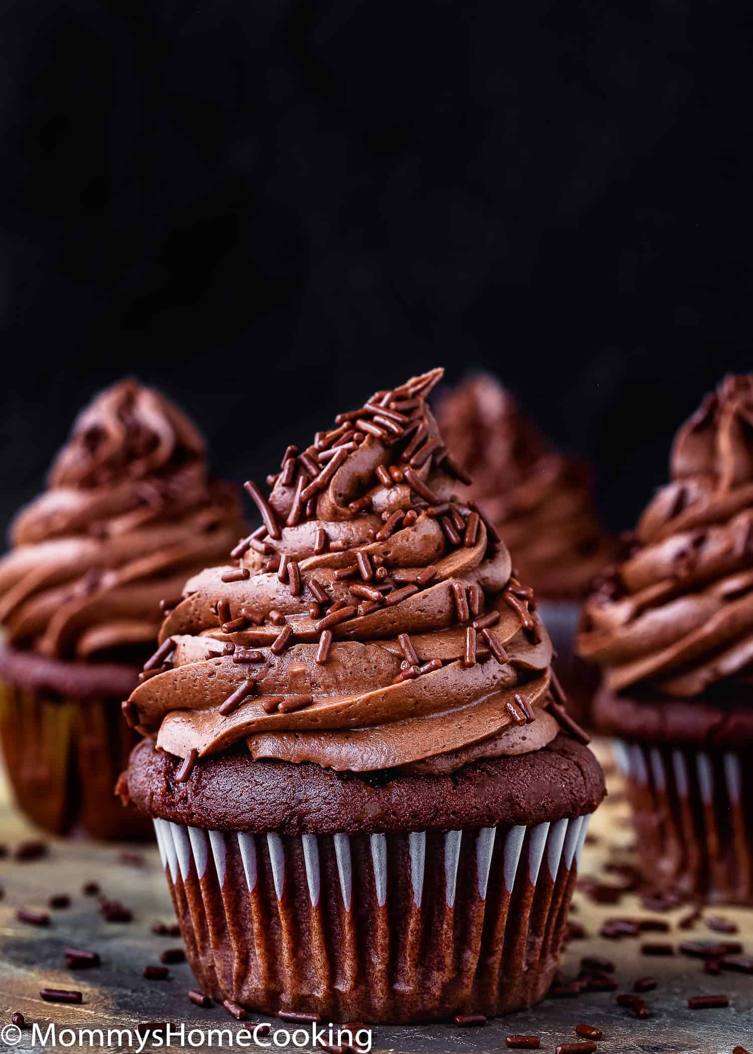 These Eggless Chocolate Cupcakes are super chocolatey, moist, rich and delicious! They're easy to make, with just a handful of ingredients. Perfect for birthday parties, gatherings, celebrations or whenever the mood strikes. https://mommyshomecooking.com