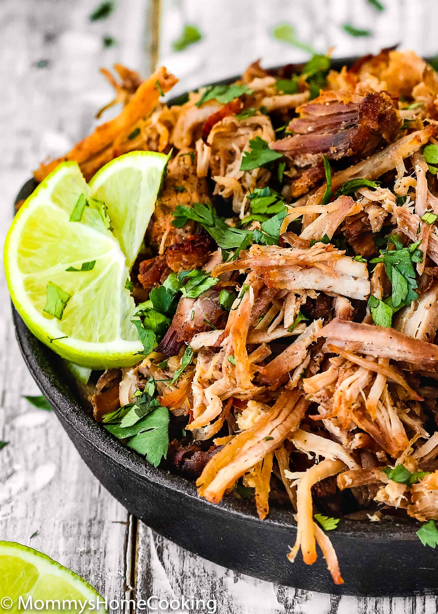 These Instant Pot Crispy Pork Carnitas are flavorful, tender, juicy, zesty, and they could not be easier to make! Toss it all in your Instant Pot, let it cook, and listo! These are great to make tacos, tostadas, sandwiches, sliders, arepas and more. Whole30 compliant. https://mommyshomecooking.com