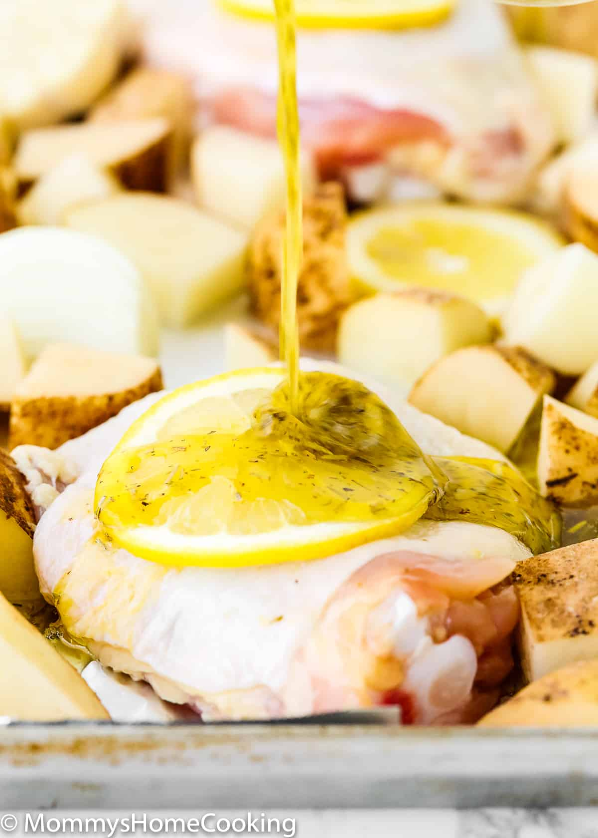 This Sheet Pan Lemon Garlic Roasted Chicken and Potatoes is incredibly simple, but seriously scrumptious! The chicken and potatoes are bathed in plenty of herbs and a delicious bright citrus sauce that will make your taste buds dance. The perfect answer to hectic weeknights. Whole 30 friendly. https://mommyshomecooking.com