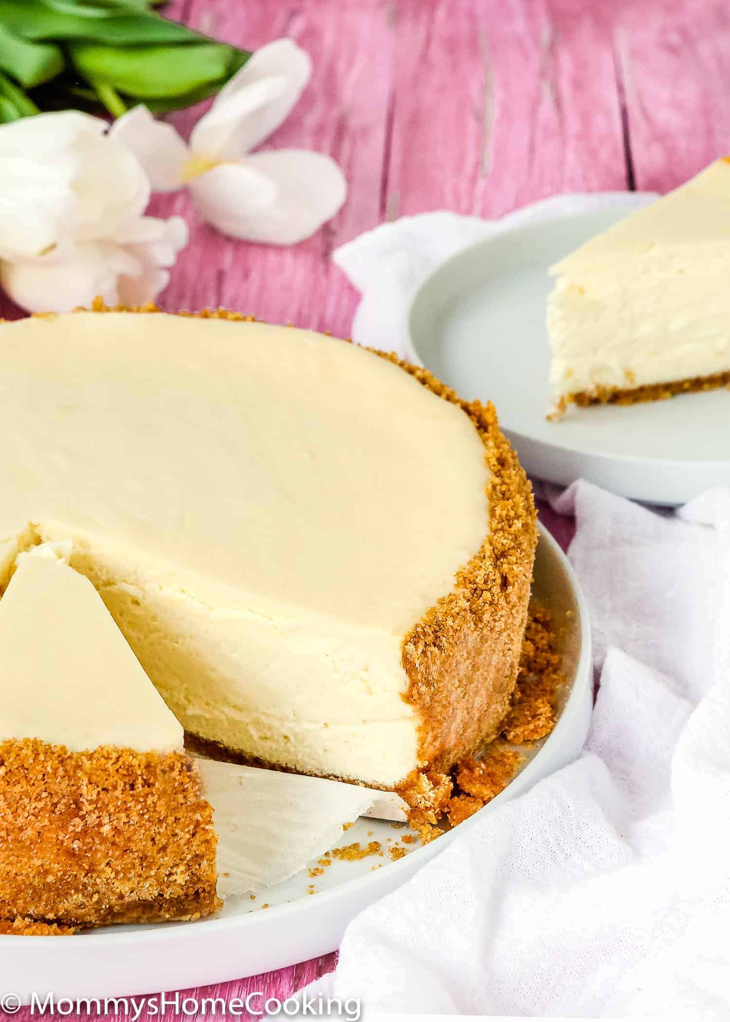 This recipe makes the BEST Eggless Cheesecake you will ever try! It's wonderfully creamy and silky, and it's also one of the easiest to make! A delicious and melt-in-your-mouth classic dessert that will leave everyone asking for seconds. Must try! https://mommyshomecooking.com