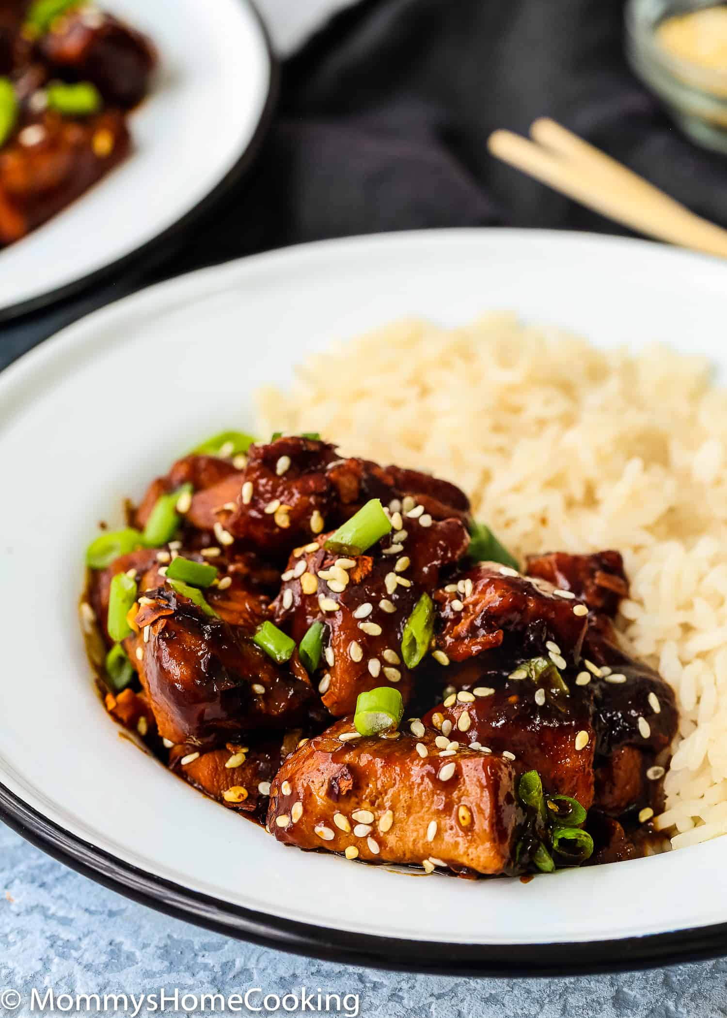 This Easy Instant Pot General Tso's Chicken is a lighter version of the iconic takeout dish! NO deep-frying needed. Tender pieces of chicken breast smothered in an amazing sweet and savory sauce with a little bit of heat! Make better than takeout right at home. Pressure cooker and slow cooker instructions included. https://mommyshomecooking.com