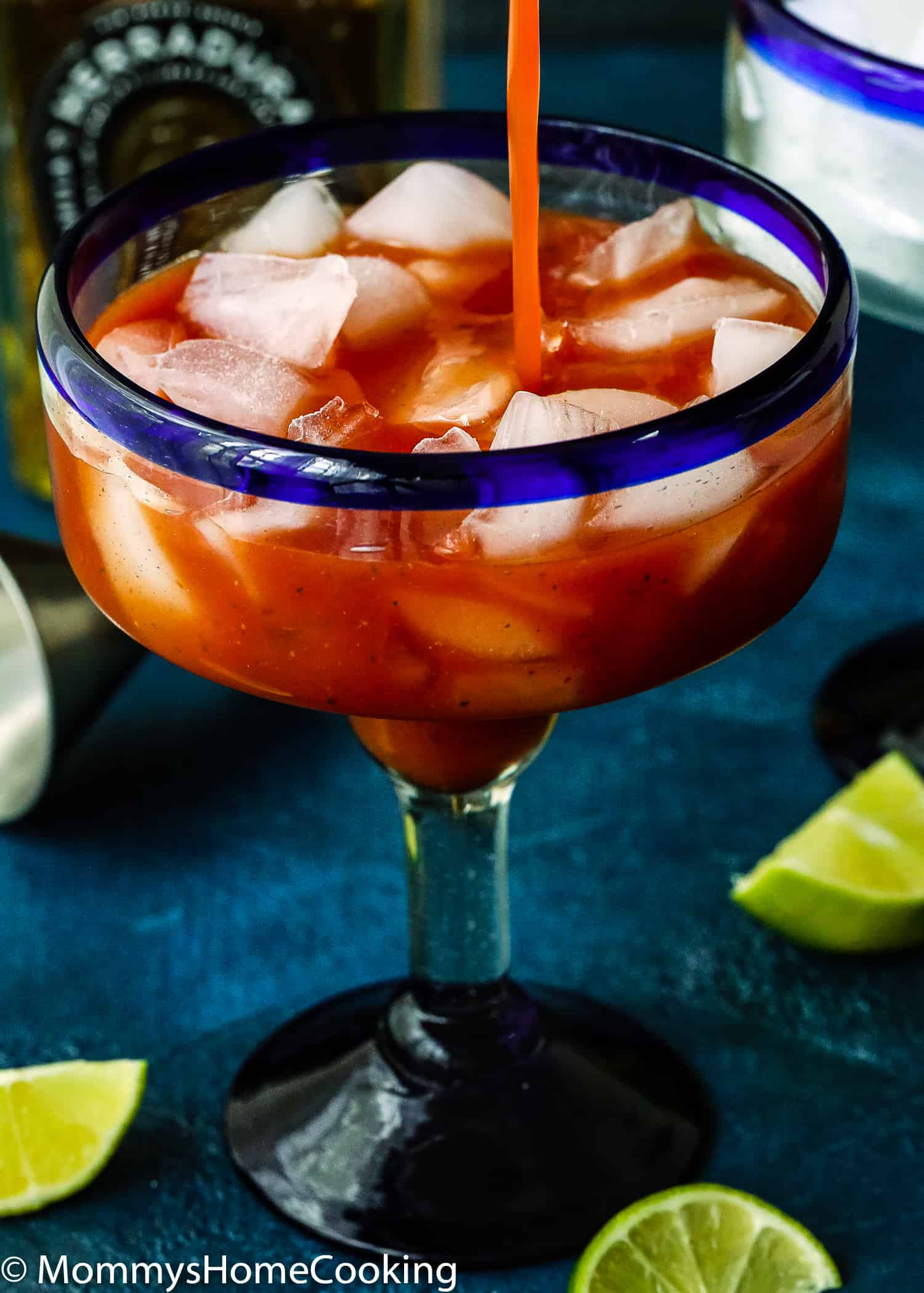 This Spicy Salsa Margarita is boozy, refreshing, citrusy and totally irresistible! This cocktail taste like the perfect combination of a bloody mary and a margarita, all in one sip. Made with fresh salsa, tequila, agave and lime, this delicious and different cocktail will knock your guests' socks off! https://mommyshomecooking.com