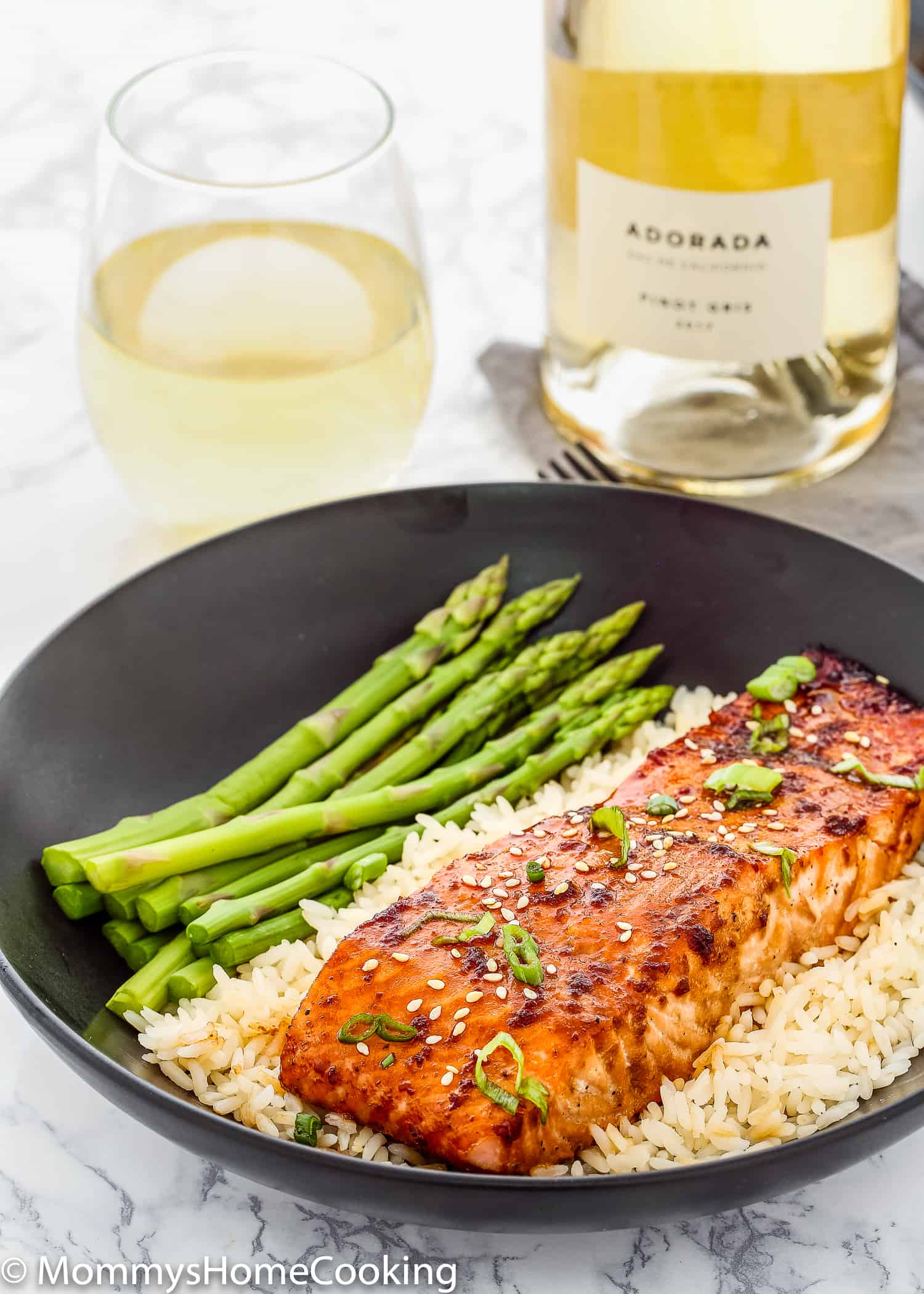 This Easy Teriyaki Salmon is tender, flaky, and packed with amazing flavor. Ready in less than 30 minutes and requires only a few ingredients. Perfect weeknight meal but fancy enough for special occasions too. https://mommyshomecooking.com