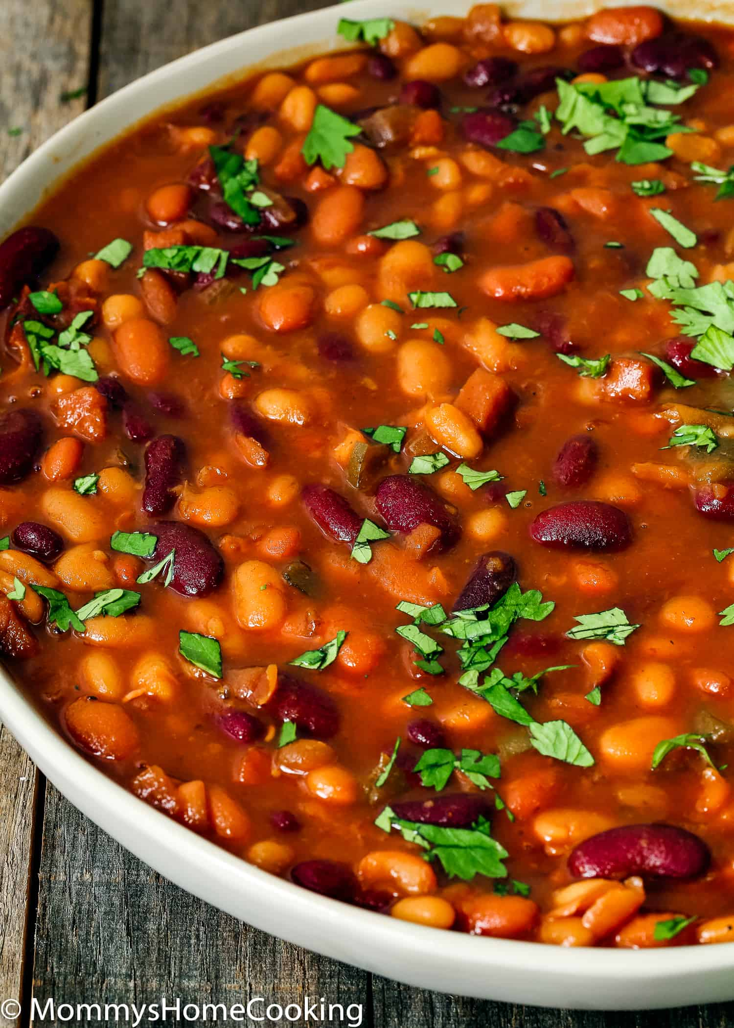These Easy Instant Pot Baked Beans are hearty, filling and super delicious! Ready in less than 30 minutes this easy Instant Pot baked beans recipe will become a favorite! Perfect for your next BBQ or potluck. https://mommyshomecooking.com