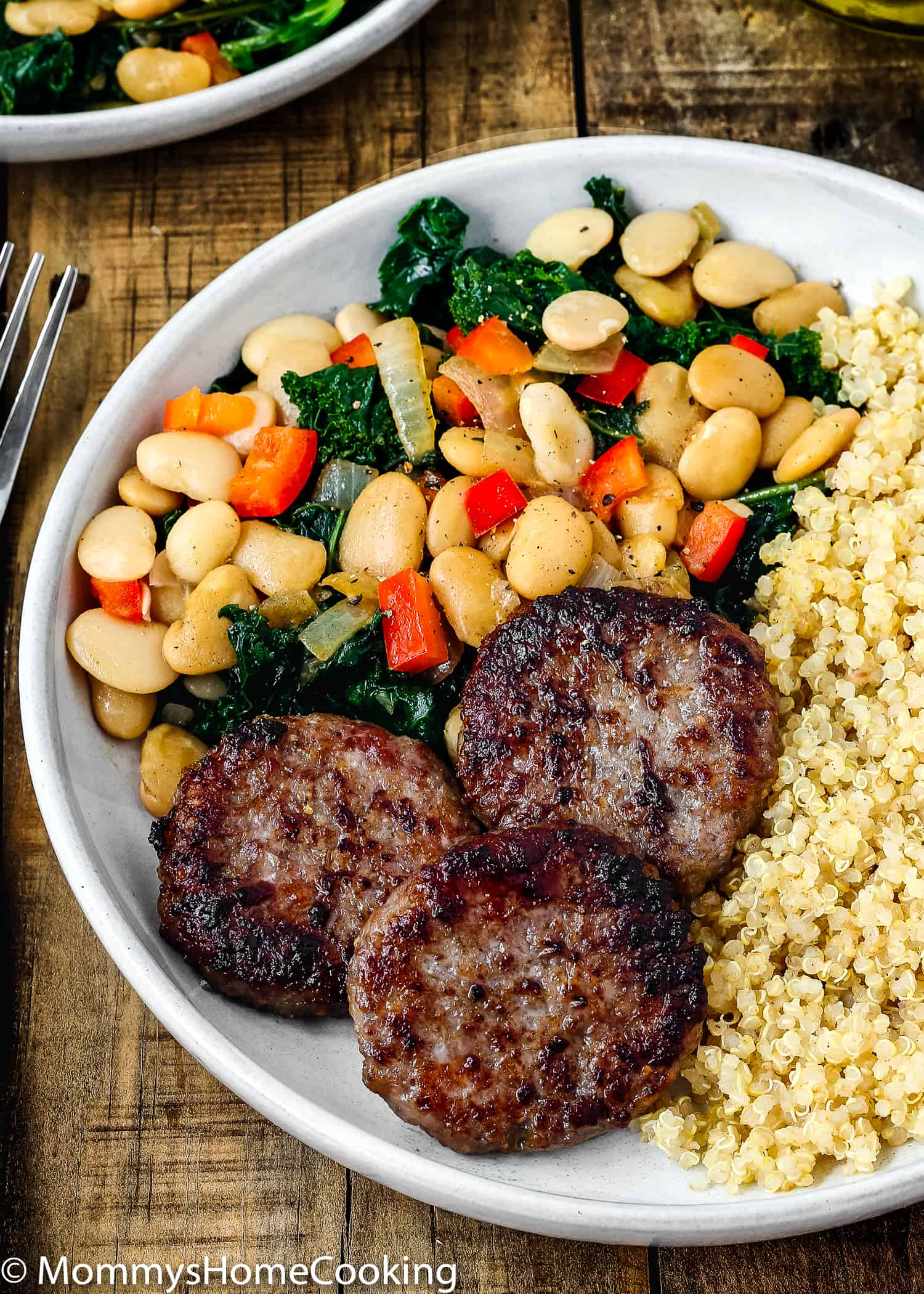 This Easy Sausage and Bean Quinoa Bowl is a delicious way to bring breakfast to the dinner table! Made with breakfast sausage, quinoa, beans, kale and veggies, this satisfying meal comes together in no time! https://mommyshomecooking.com