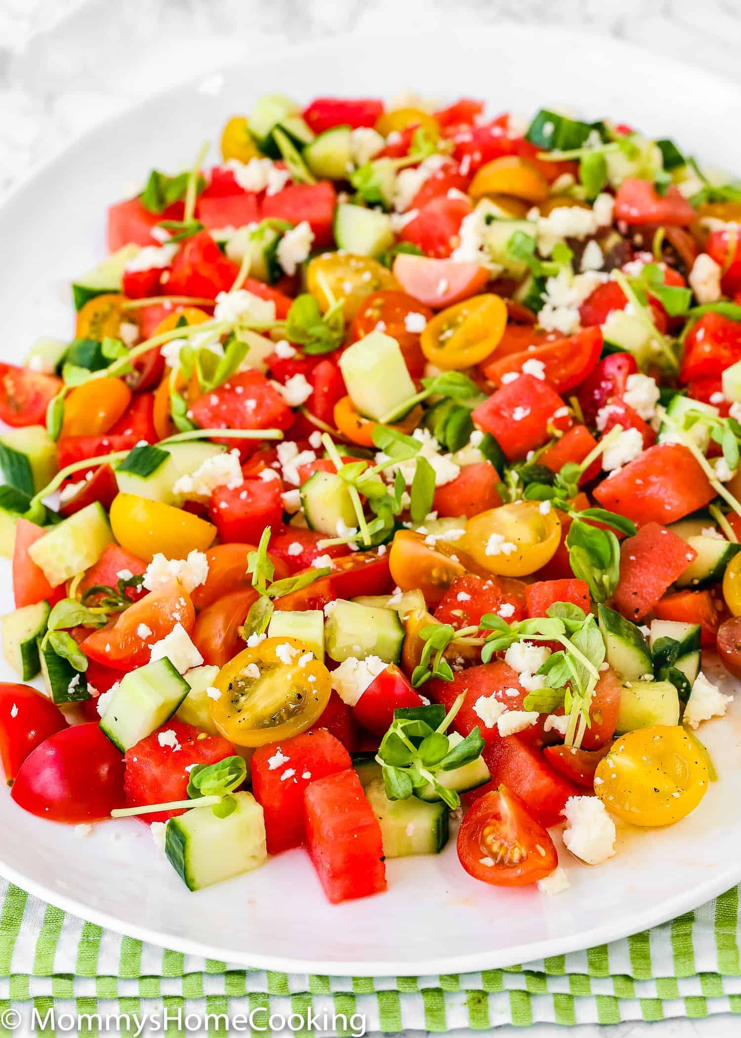 This sweet and savory Easy Watermelon Summer Salad is perfect for summer! You just need to cut out some fresh ingredients, toss and enjoy. All the goodness without the guilt. Done in 15 minutes. https://mommyshomecooking.com