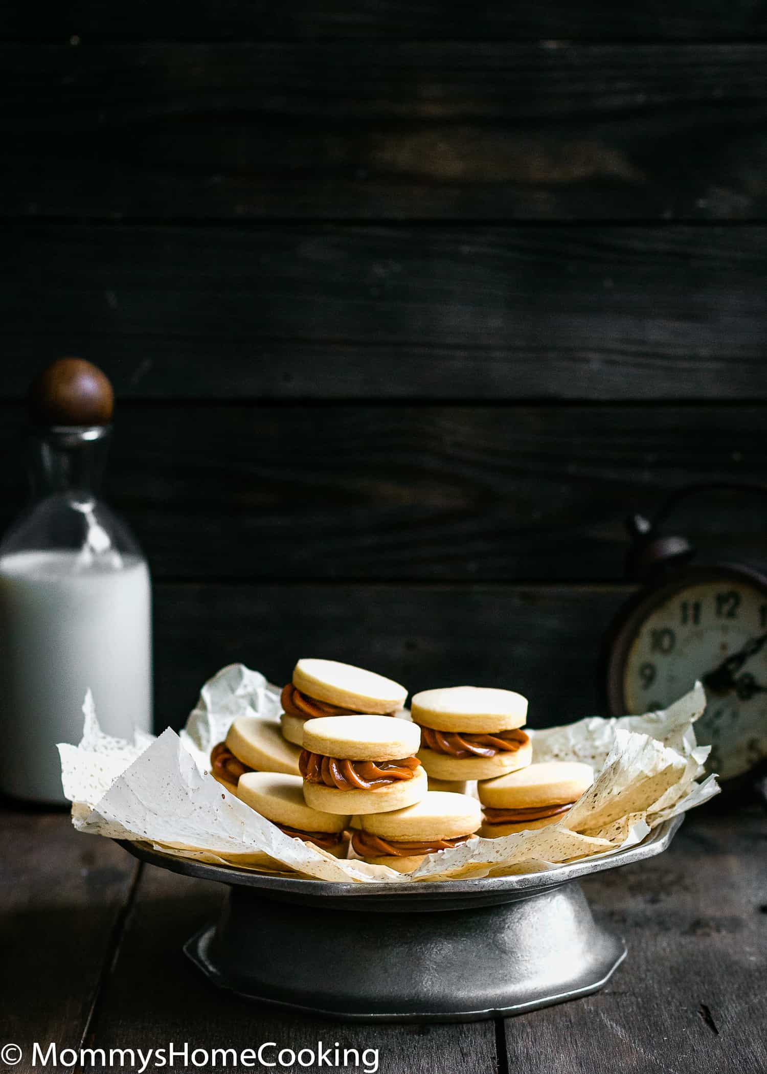 What is better than a cookie? A Sandwich Cookie!! These Eggless Dulce de Leche Shortbread Sandwich Cookies are buttery, rich incredibly tender and delicious. 9 filling ideas included. https://mommyshomecooking.com