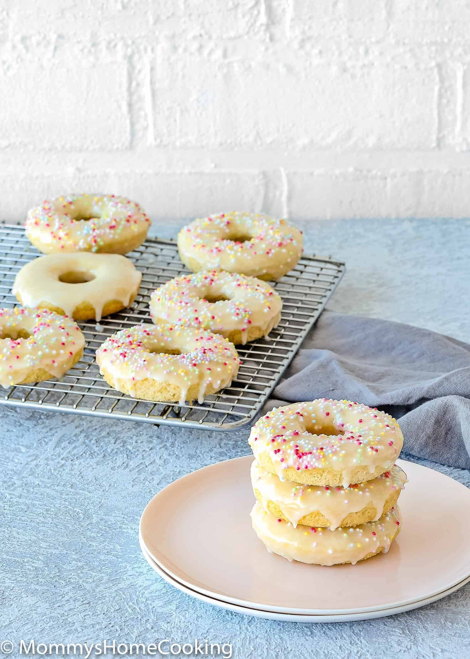 These Easy Eggless Baked Donuts are heavenly moist and cakey! This basic eggless baked donuts recipe is simple and easy to follow. They're perfect for any occasion and sure to be your family's favorite! https://mommyshomecooking.com