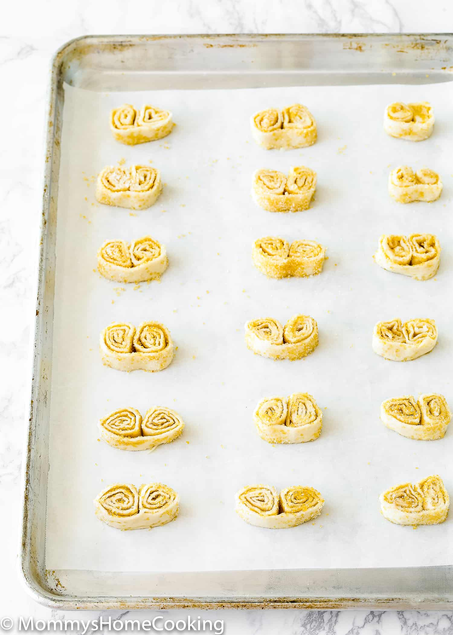 "This Easy Palmiers recipe, made with just 2 ingredients, is one of my family's all-time favorite treats! Perfect to share with family and friends during ""Cafecito"" time. https://mommyshomecooking.com"