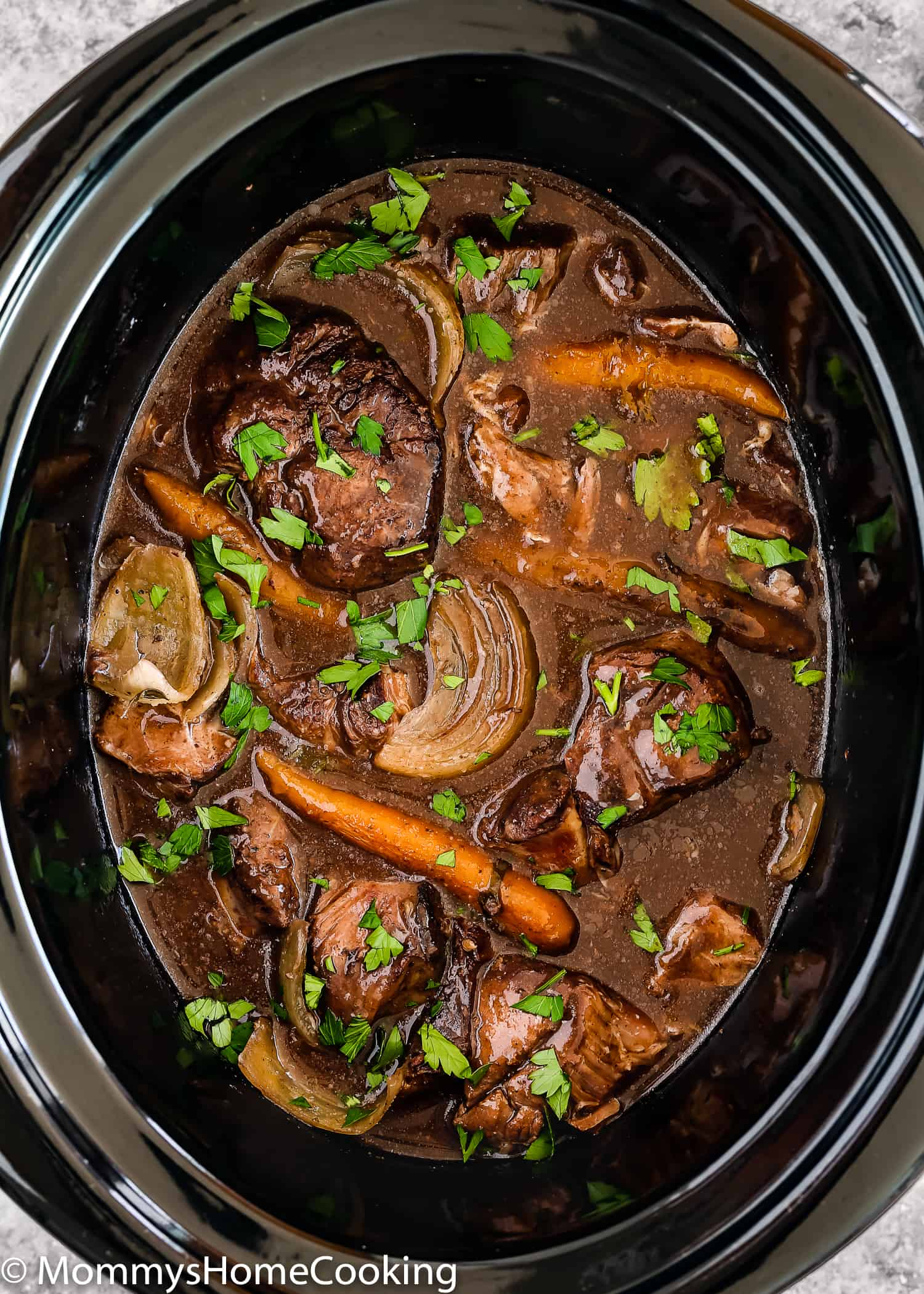 This Slow Cooker Red Wine Hind Shank is rich, hearty and super satisfying. Cook it in a slow cooker for really tender meat, this classic beef stew is enveloped in a tasty, deeply red wine flavored sauce. https://mommyshomecooking.com