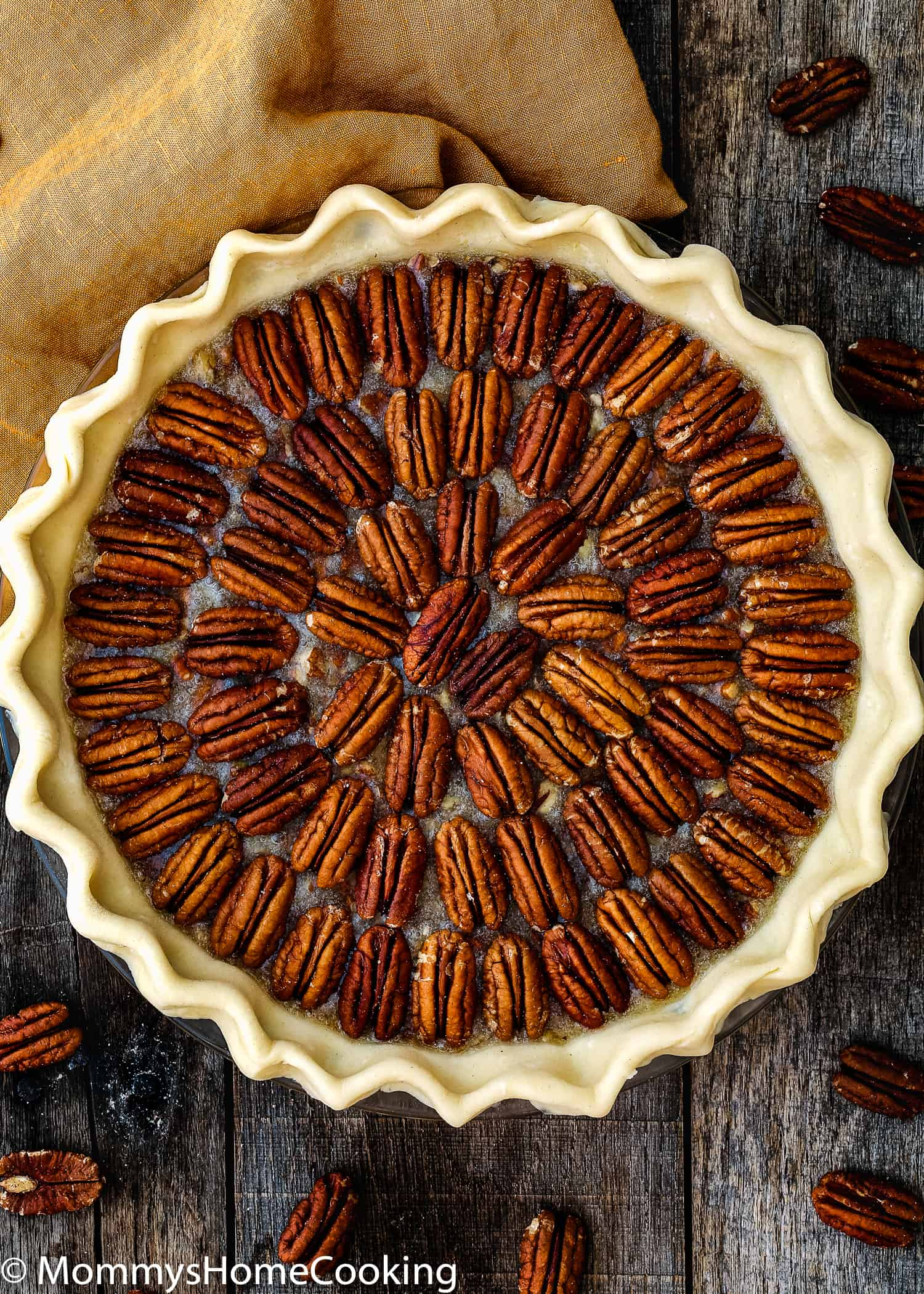 This uber-delicious Easy Eggless Pecan Pie is a MUST-MAKE for the holidays! With its crispy top, the gooey center and the flaky crust, this Thanksgiving classic dessert will wow you and your guests. Easy to make, easier to eat. https;//mommyshomecooking.com
