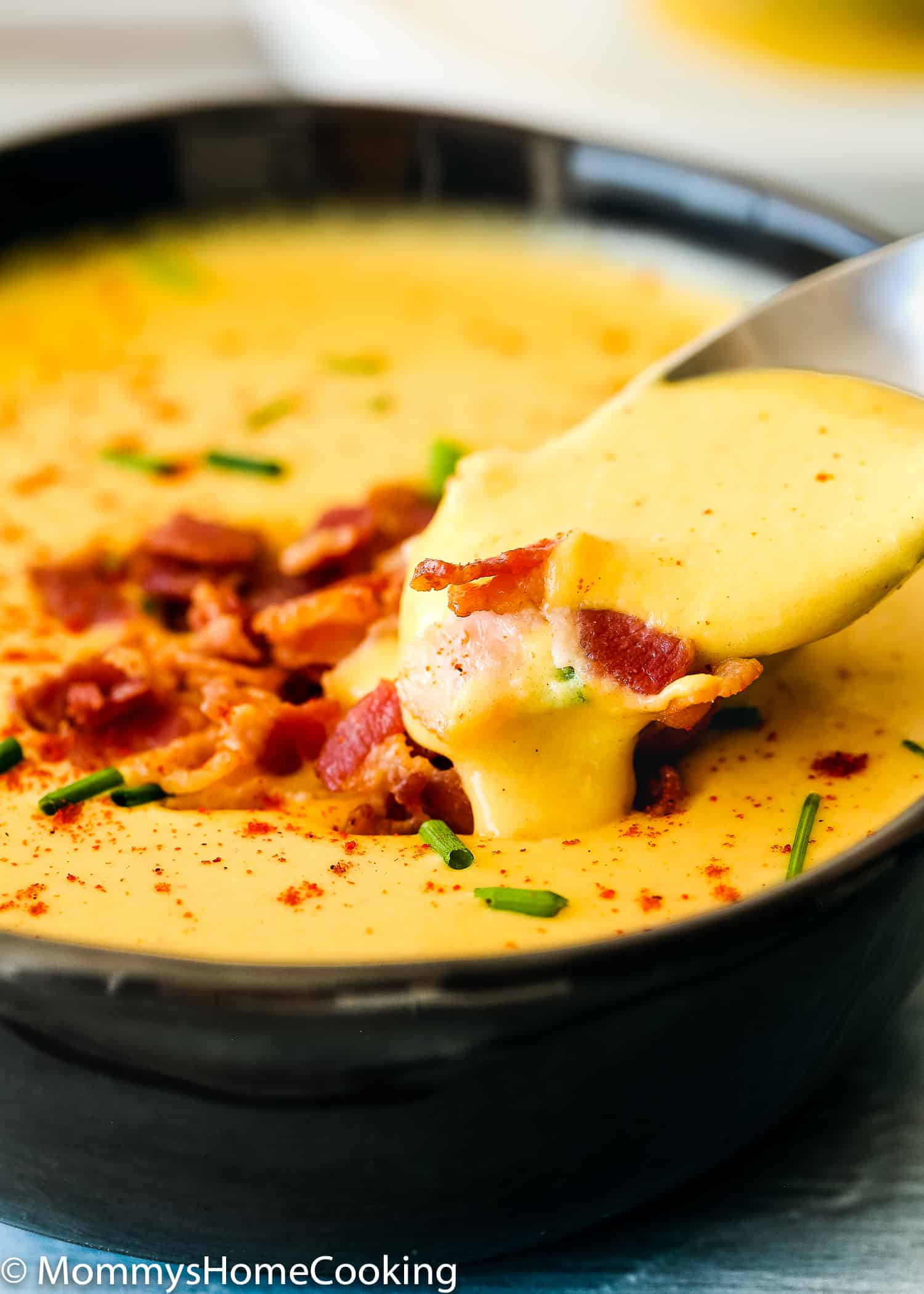 This Instant Pot Smoky Cheese and Potato Soup recipe is the perfect way to savor cheese with a spoon. This delicious silky-smooth pureed soup is made with tons of smoked cheese, potatoes and a combination of spices that makes it totally irresistible. https://mommyshomecooking.com