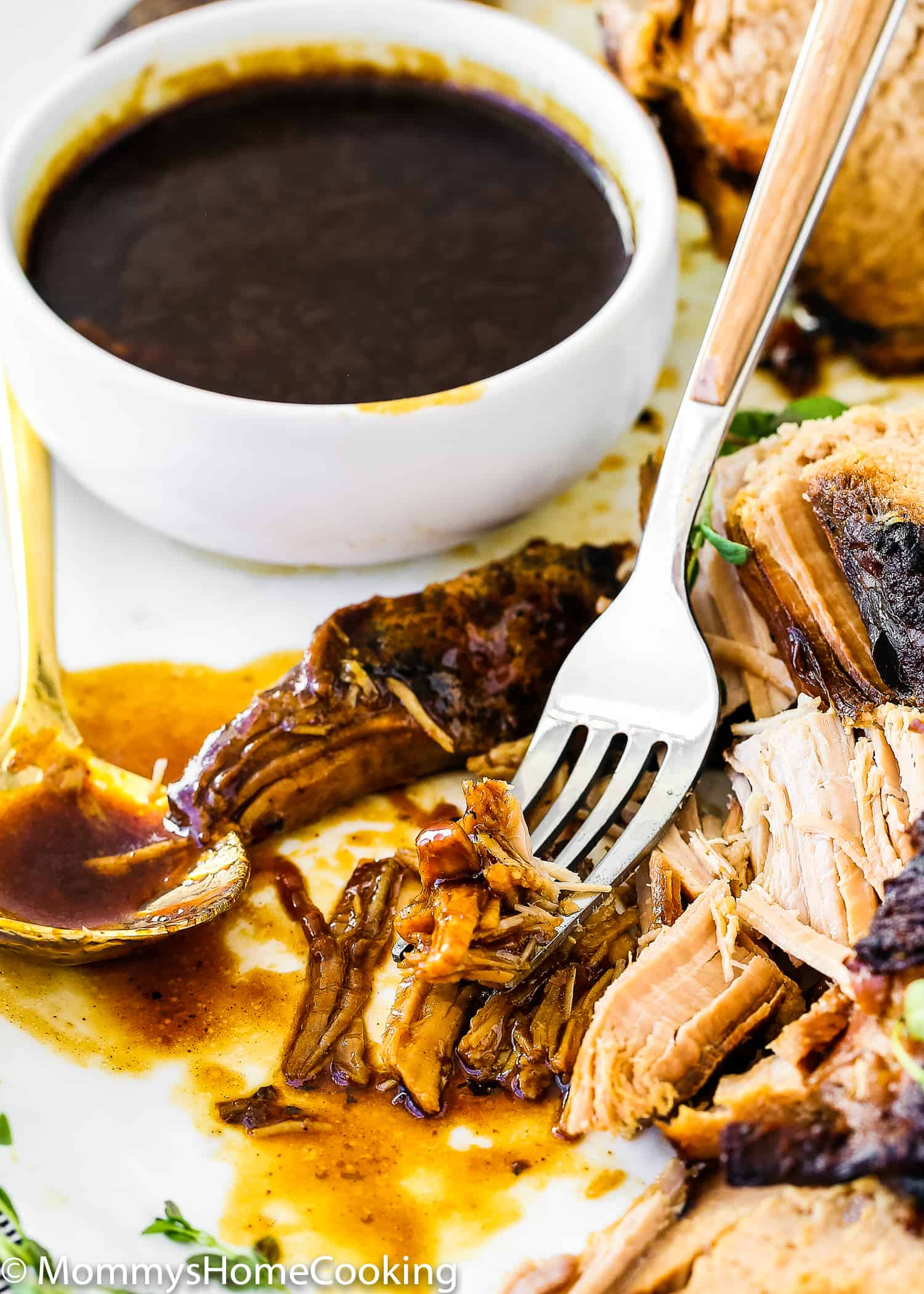 This Slow Cooker Honey Balsamic Pork Loin is tender, juicy and fall-apart delicious! Smothered in a rich honey balsamic sauce, this pork loin is easy for weeknight dinner yet fancy, elegant and impressive enough for company. https://mommyshomecooking.com