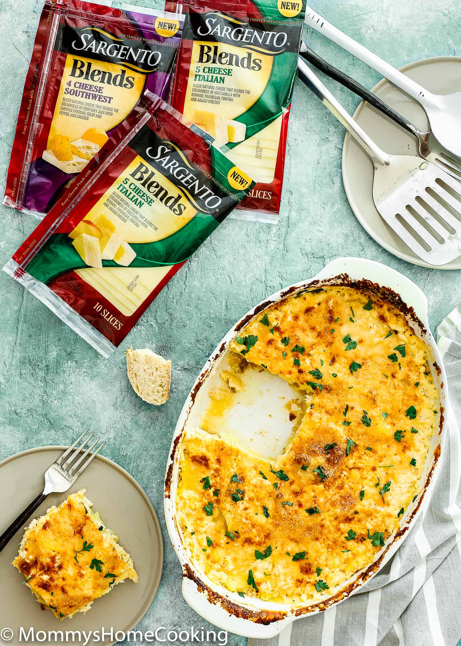This Cheesy Potatoes and Cod Casserole recipe is cheesy, creamy, and easy to make! Loaded Potato, cheese and cod, this dish is a whole dinner in one! For sure a go-to dinner for any day of the week. https://mommyshomecooking.com