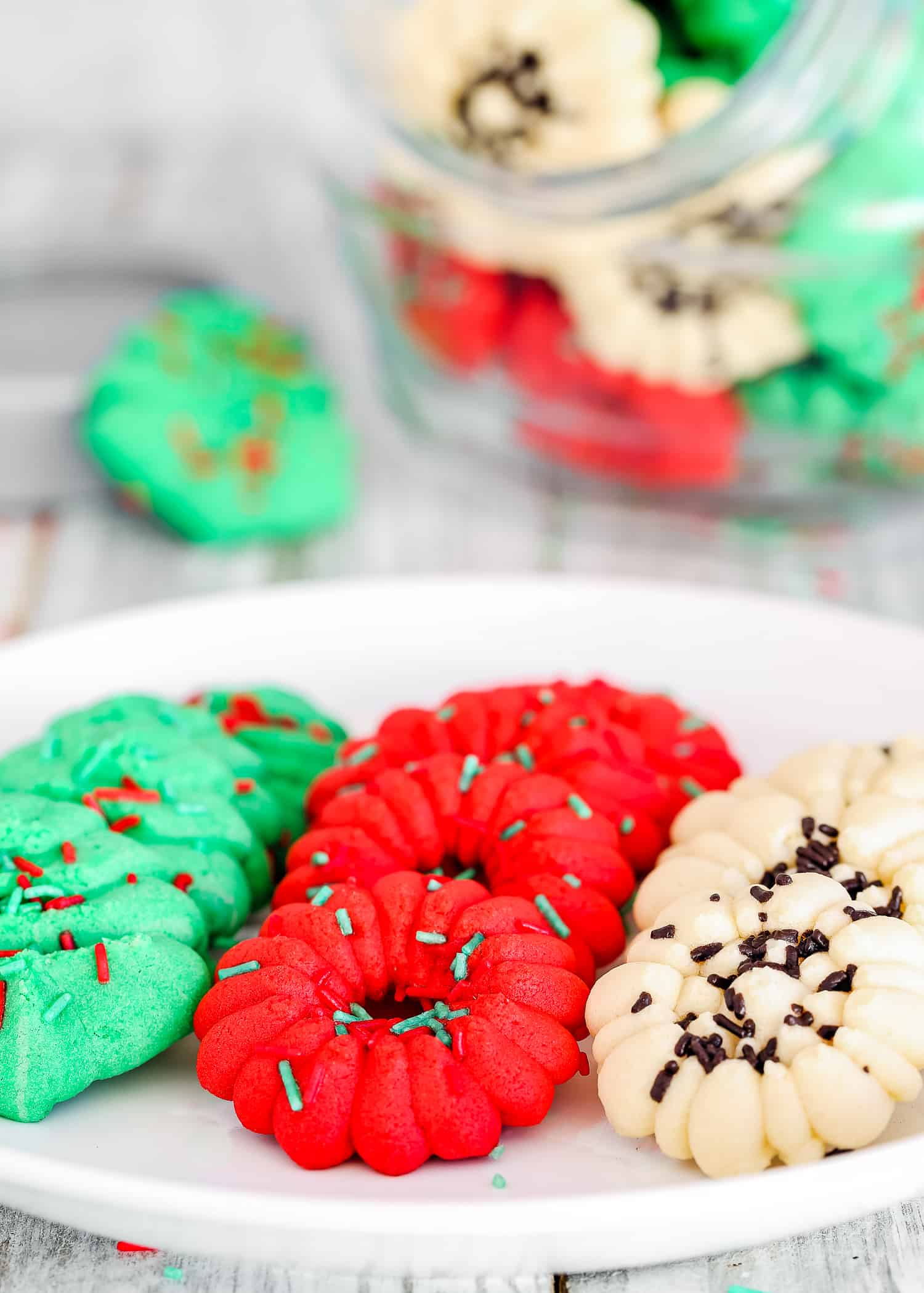 These Easy Eggless Spritz Cookies are tender, light, buttery and totally delicious. Easy and quick to make; no cookie dough chilling required. These egg-free cookies will make a great dessert contribution to any holiday party. https://mommyshomecooking.com