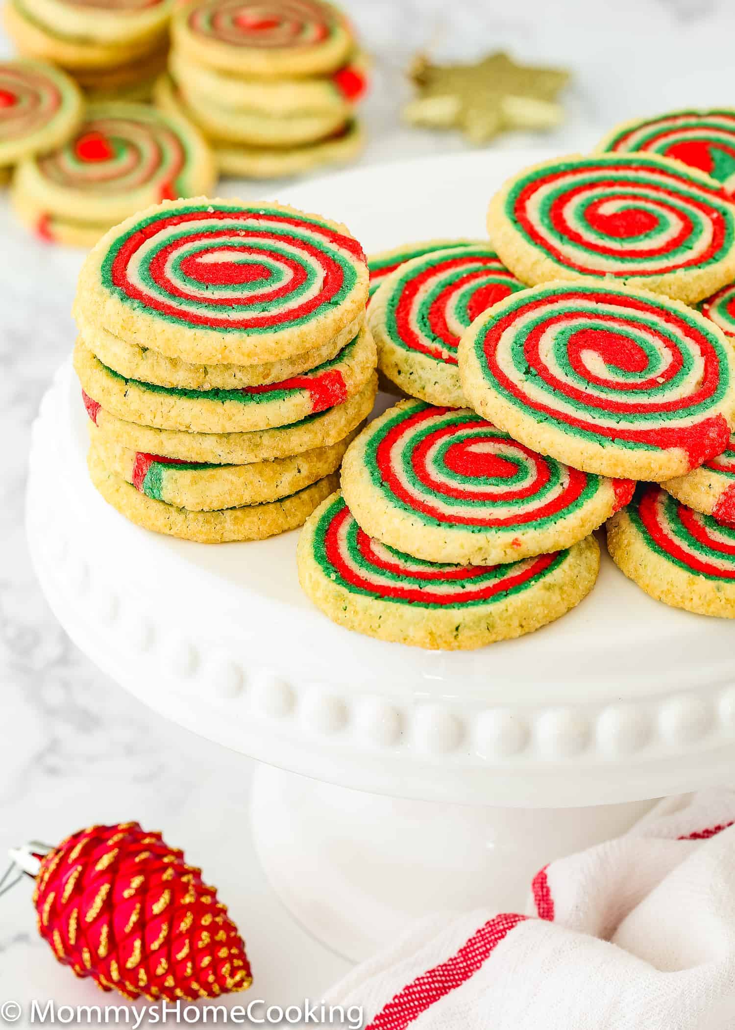 These Eggless Icebox Christmas Pinwheel Cookies are our family's new favorite Christmas cookie recipe! They're crisp and buttery, and so fun to make. Great for gifting or leaving out for Santa. https://mommyshomecooking.com