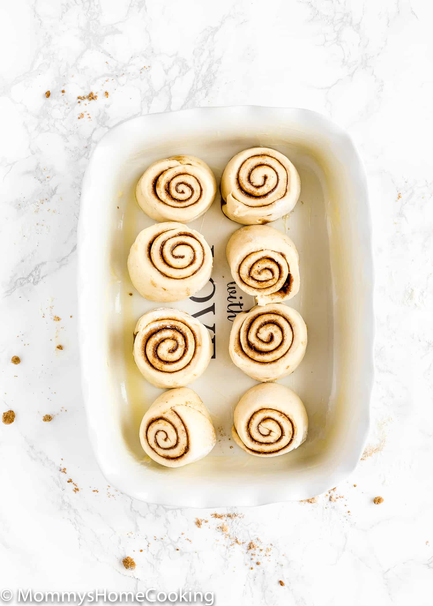 These Easy Eggless Cinnamon Rolls are fluffy, soft and are ready in about 1 hour! Made from scratch and totally delicious, this Eggless Cinnamon Rolls recipe is perfect for breakfast brunch or just dessert. Step-by-step photos and overnight instructions included. https://mommyshomecooking.com
