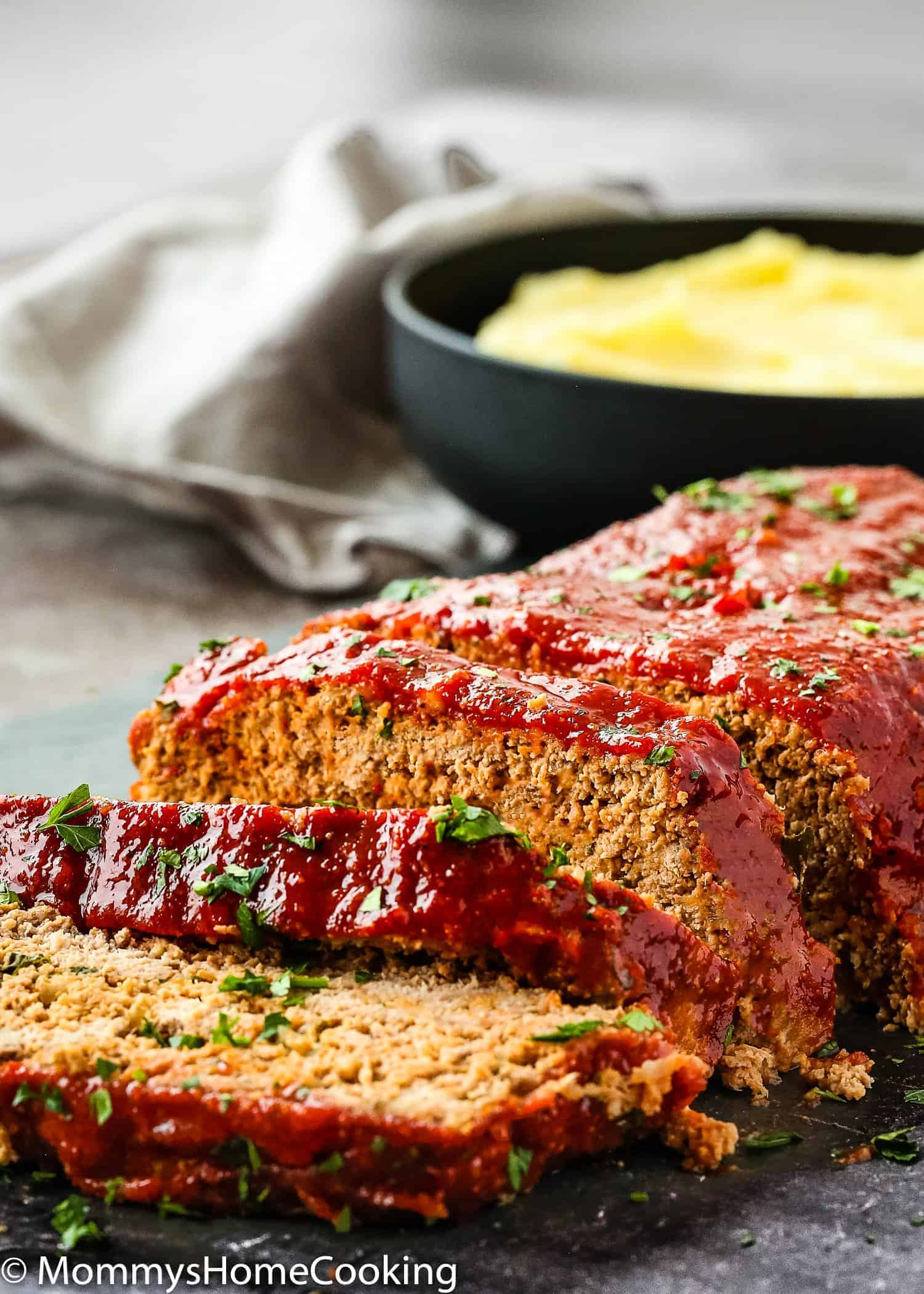 This Easy Eggless Meatloaf is tasty, tender, and juicy, yet holds together well when sliced. Made with simple ingredients, this eggless meatloaf is very easy to make and will satisfy even the pickiest eaters! Make ahead, freezing tips, and many tricks included. https://mommyshomecooking.com