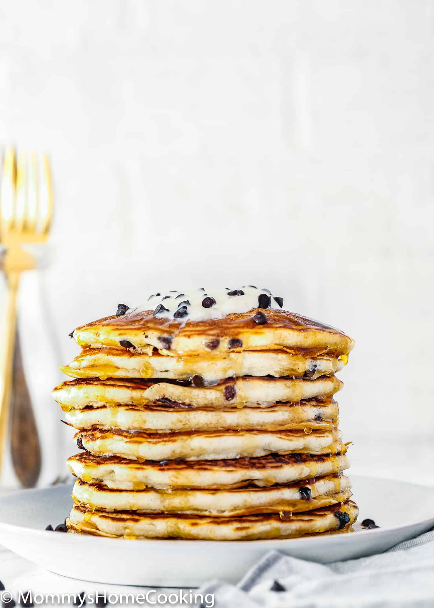This Easy Eggless Chocolate Chip Pancakes recipe makes light and fluffy pancakes that are great for breakfast or brunch. They require a few simple ingredients you probably have in your kitchen right now. Freezing instructions included. https://mommyshomecooking.com