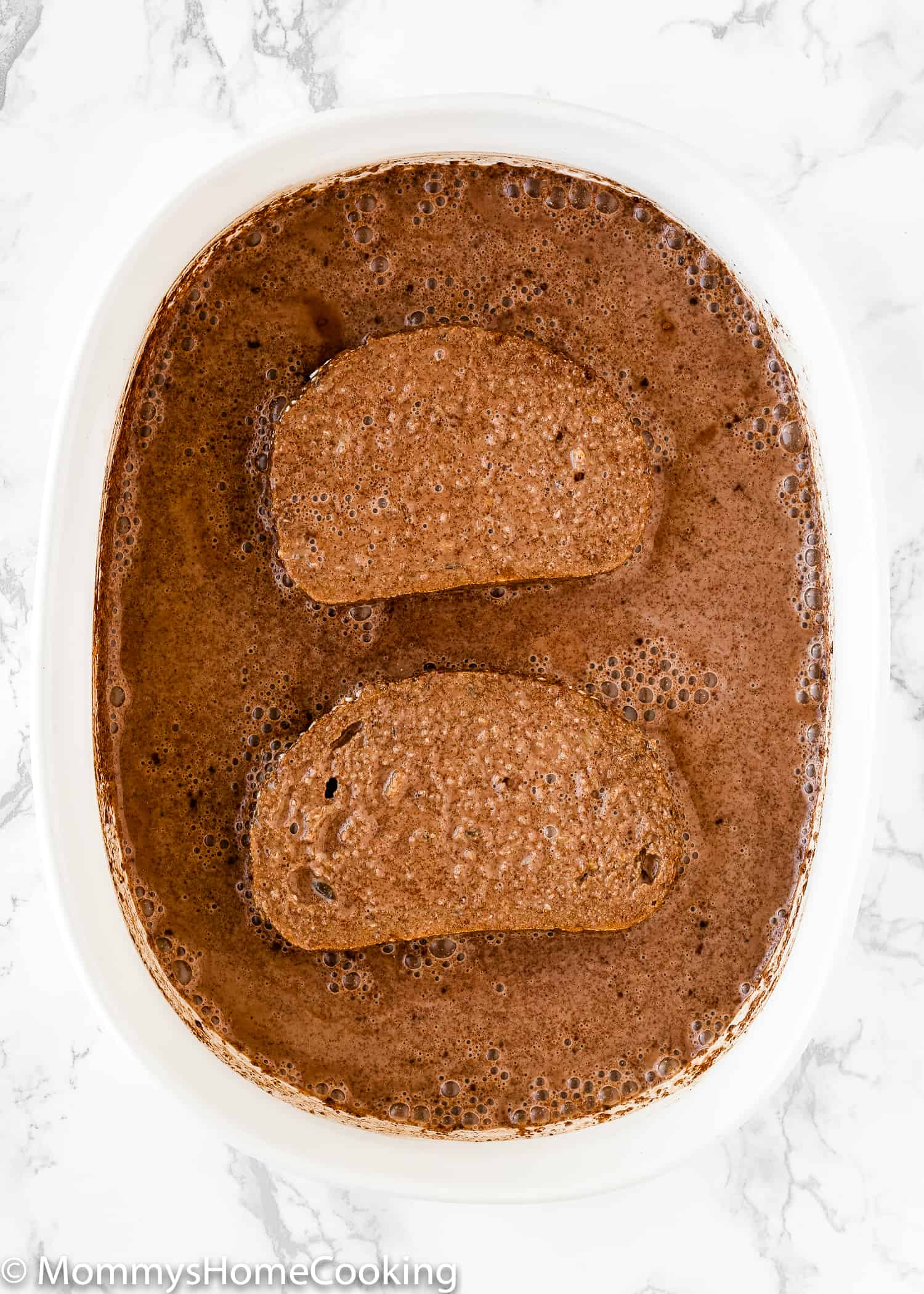 This Easy Eggless Chocolate French Toast is delicious, ridiculously easy to make and will be ready in a flash! With slightly crisp outsides, and light yet custardy insides, this chocolate French toast is perfect to satisfy those sweet-tooth cravings. https://mommyshome cooking.com