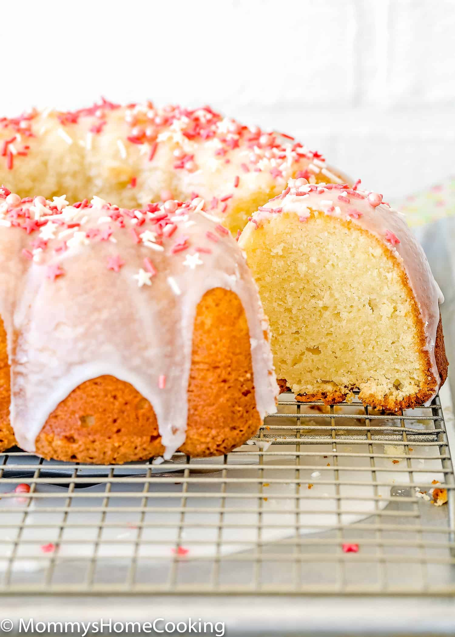 Easy Eggless Vanilla Pound Cake over a cooling rack