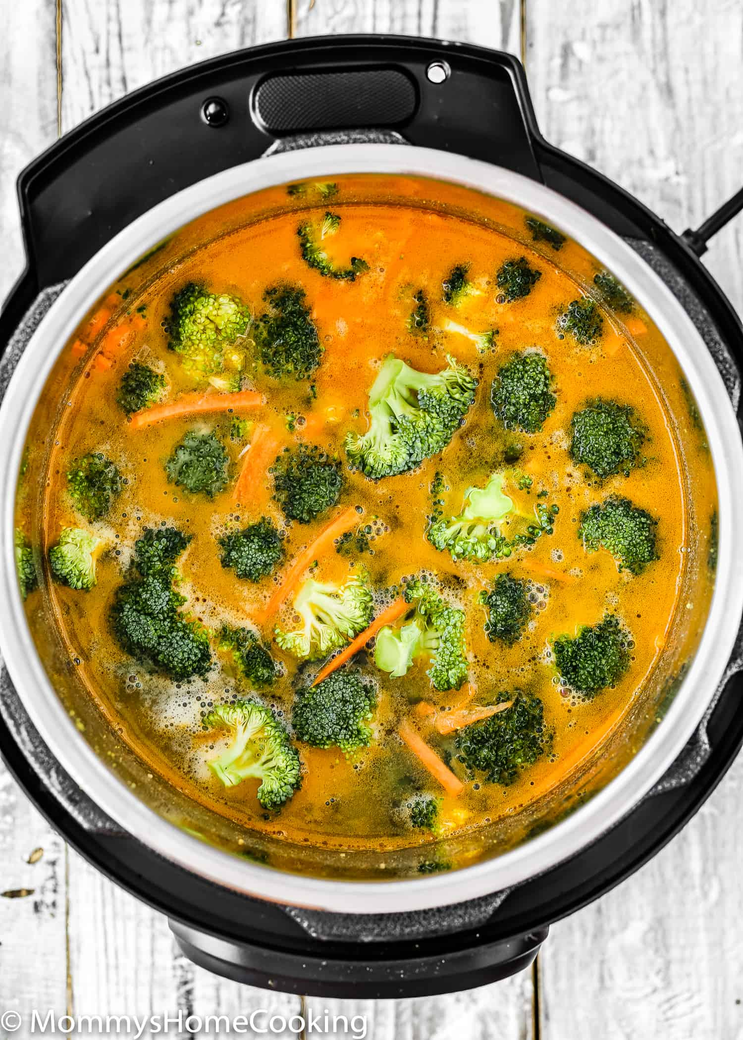 This Quick and Easy Instant Pot Broccoli Cheddar Cheese Soup Recipe is pure comfort food at its best! It's creamy, rich, and oh so cheesy. The best part is that this soup is ready in about 20 minutes fromstart to finish! https://mommyshomecooking.com