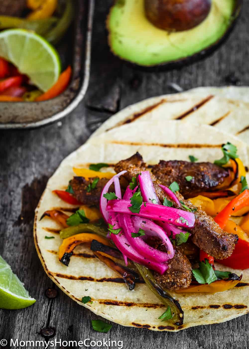 This Easy Sheet Pan Beef Fajitas is zesty, bright, and mess-free! The secret lies in a flavorful marinade. Seasoned beef is oven-broiled on a sheet pan with a mixture of peppers and onions. https://mommyshomecooking.com