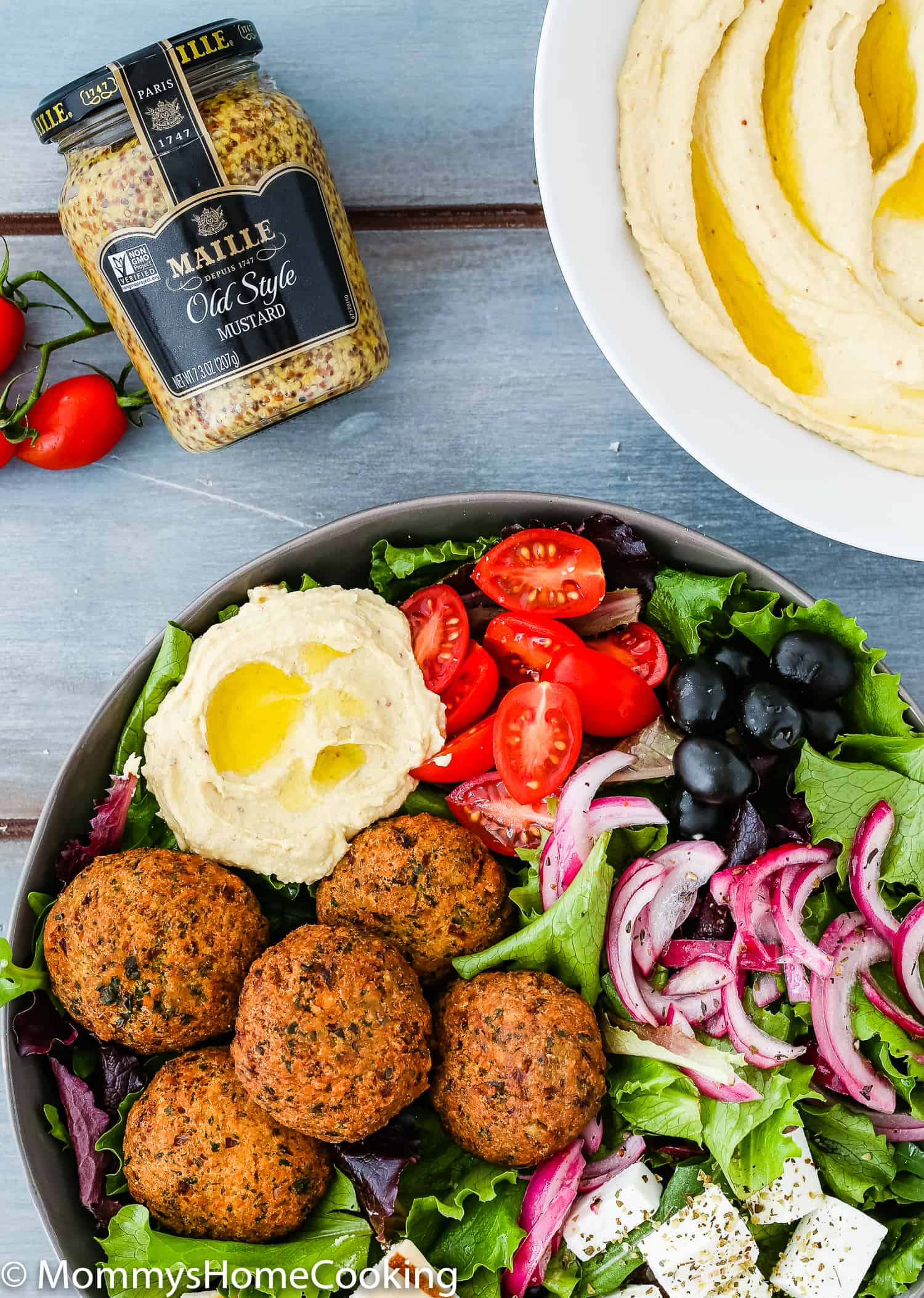 This Falafel Salad Bowls with Mustard Hummus is a burst of Mediterranean flavors in every bite! It's not only easy to make, but delicious and satisfying too. A perfect meatless meal to share with family and friends during lent time! https://mommyshomecooking.com