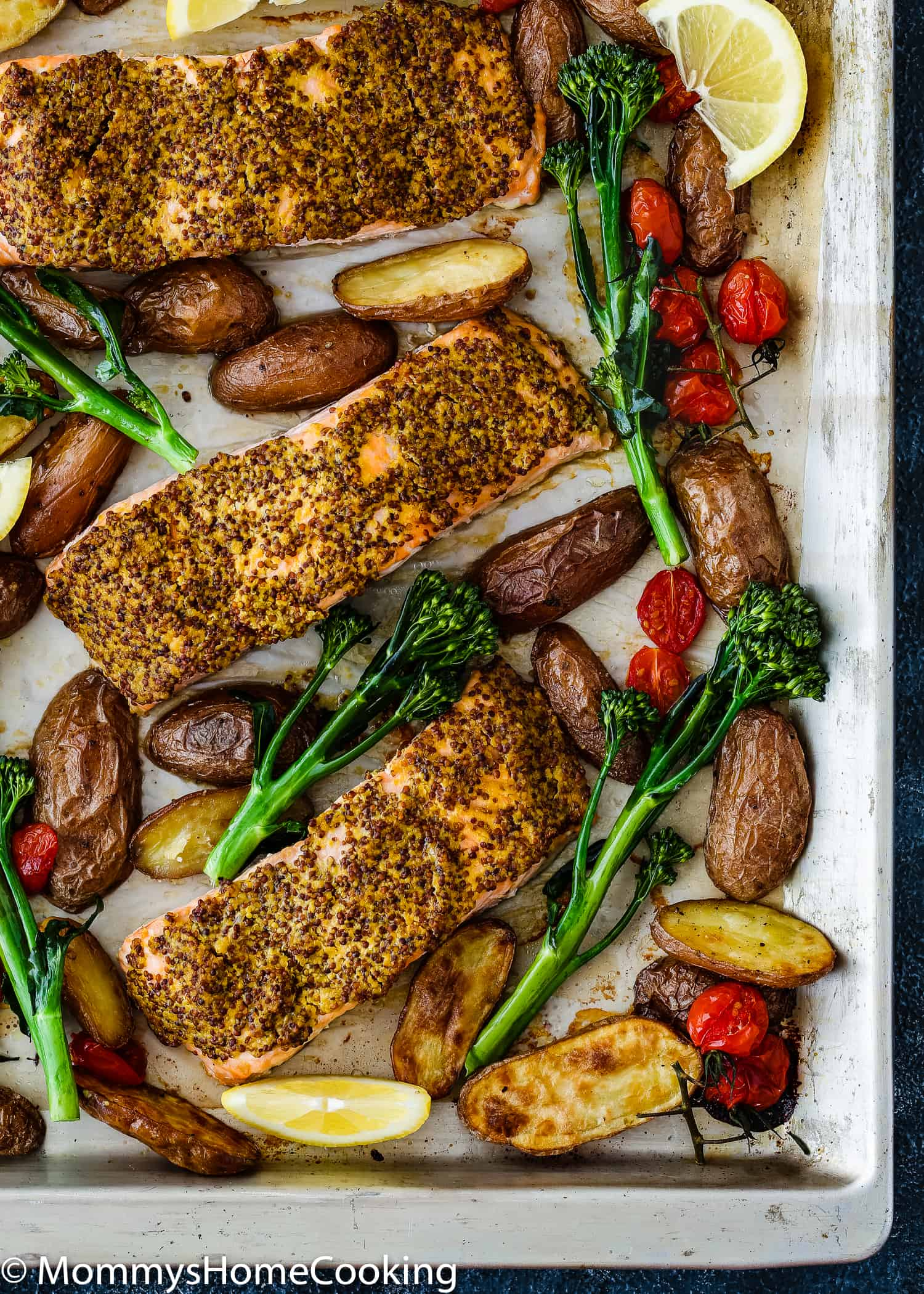 Sheet Pan with Salmon Filets, roasted potatoes, tomatoes.