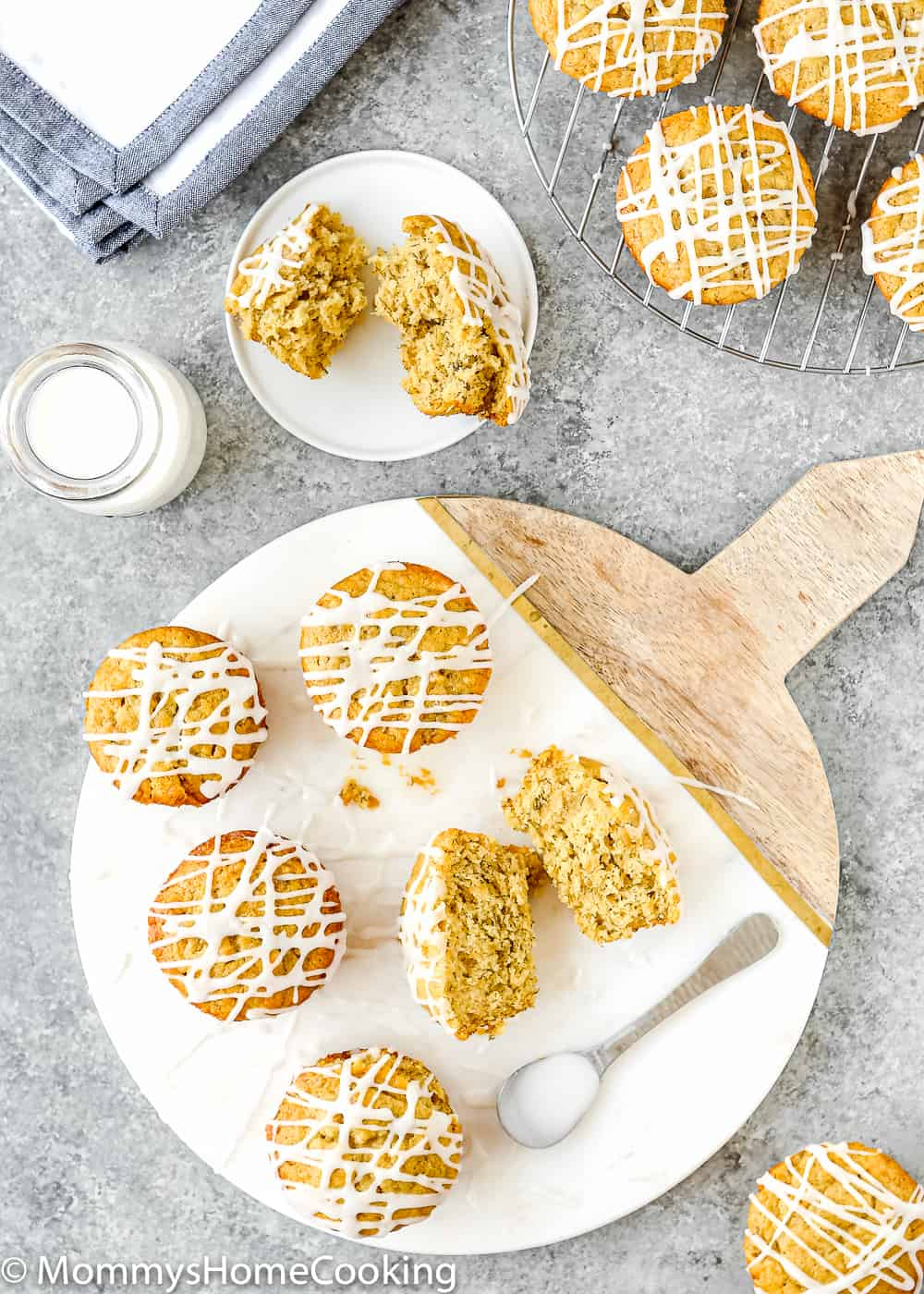 Eggless Banana Bread muffins drizzled with sugar glaze and a glass of milk