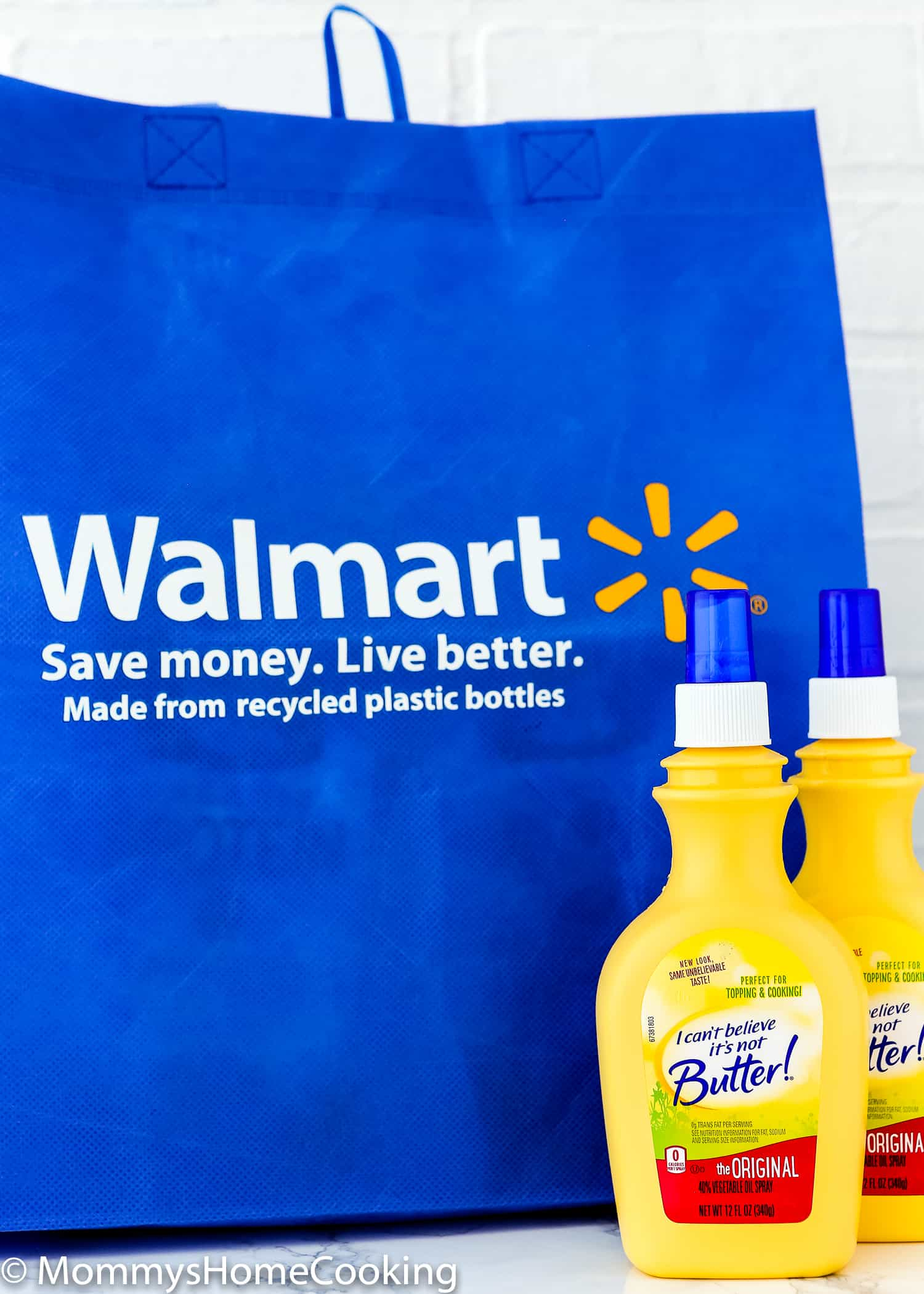 two bottles of I Can't Believe It's Not Butter! Original Spray  and a Walmart blue bag