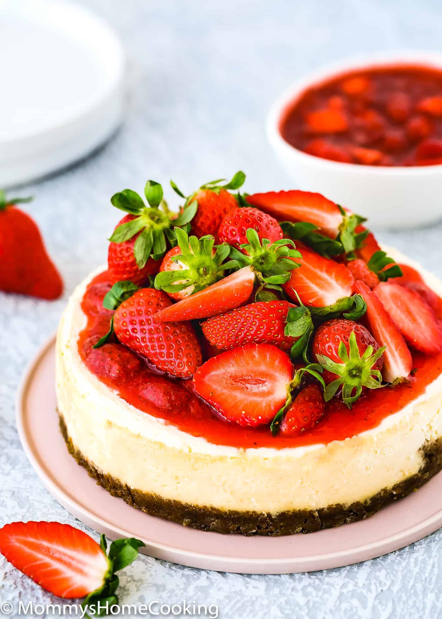eggless cheesecake made in the instant pot topped with strawberry sauce