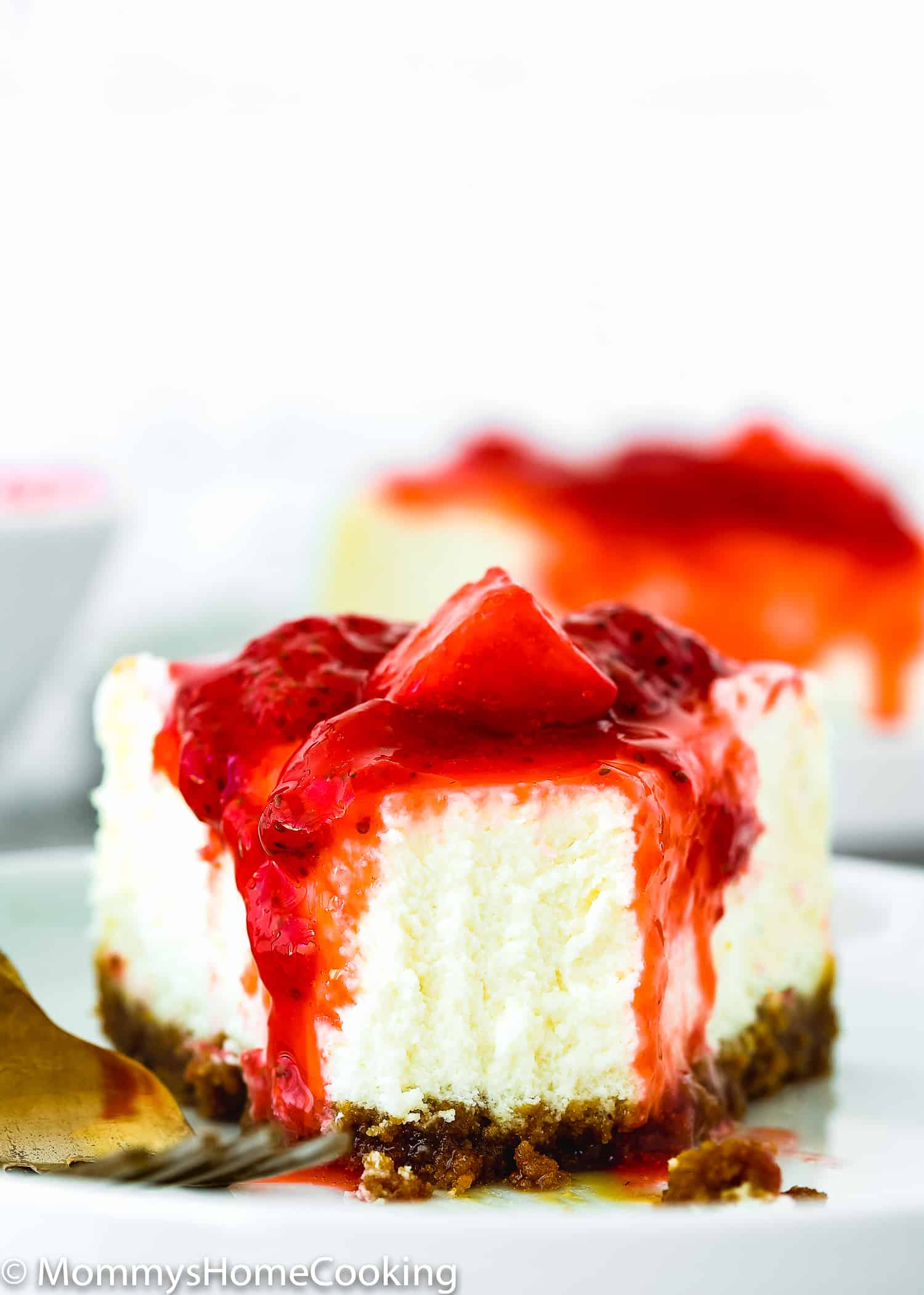 slice of eggless cheesecake cover with strawberry sauce/topping