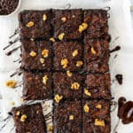 overhead view of Eggless Fudgy Zucchini Brownies over a wooden spoon