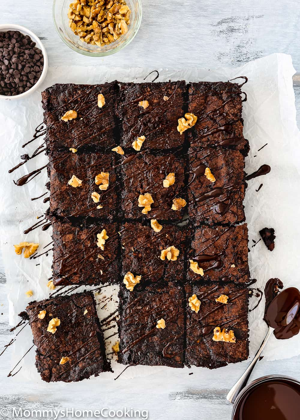 Eggless Fudgy Zucchini Brownies cut into square drizzle with chocolate and chopped walnuts
