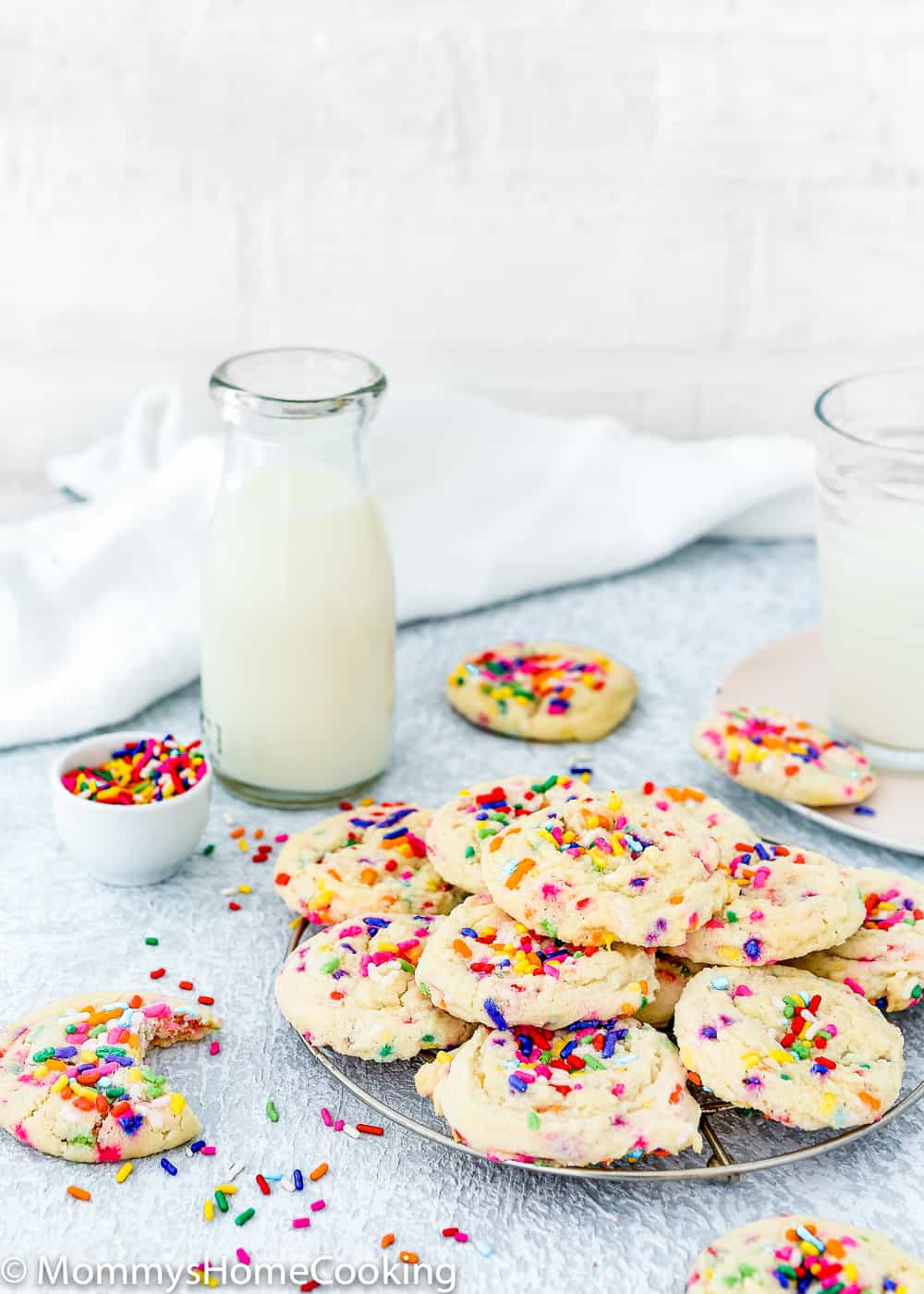 Easy Eggless Funfetti Cookies with glasses of milk