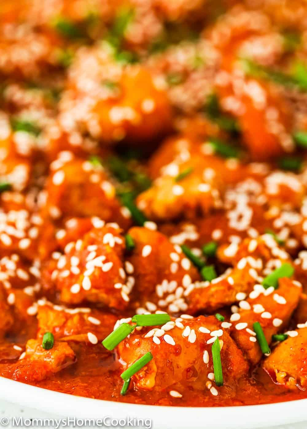 easy and tender Instant Pot Korean Kimchi Chicken in a white plate
