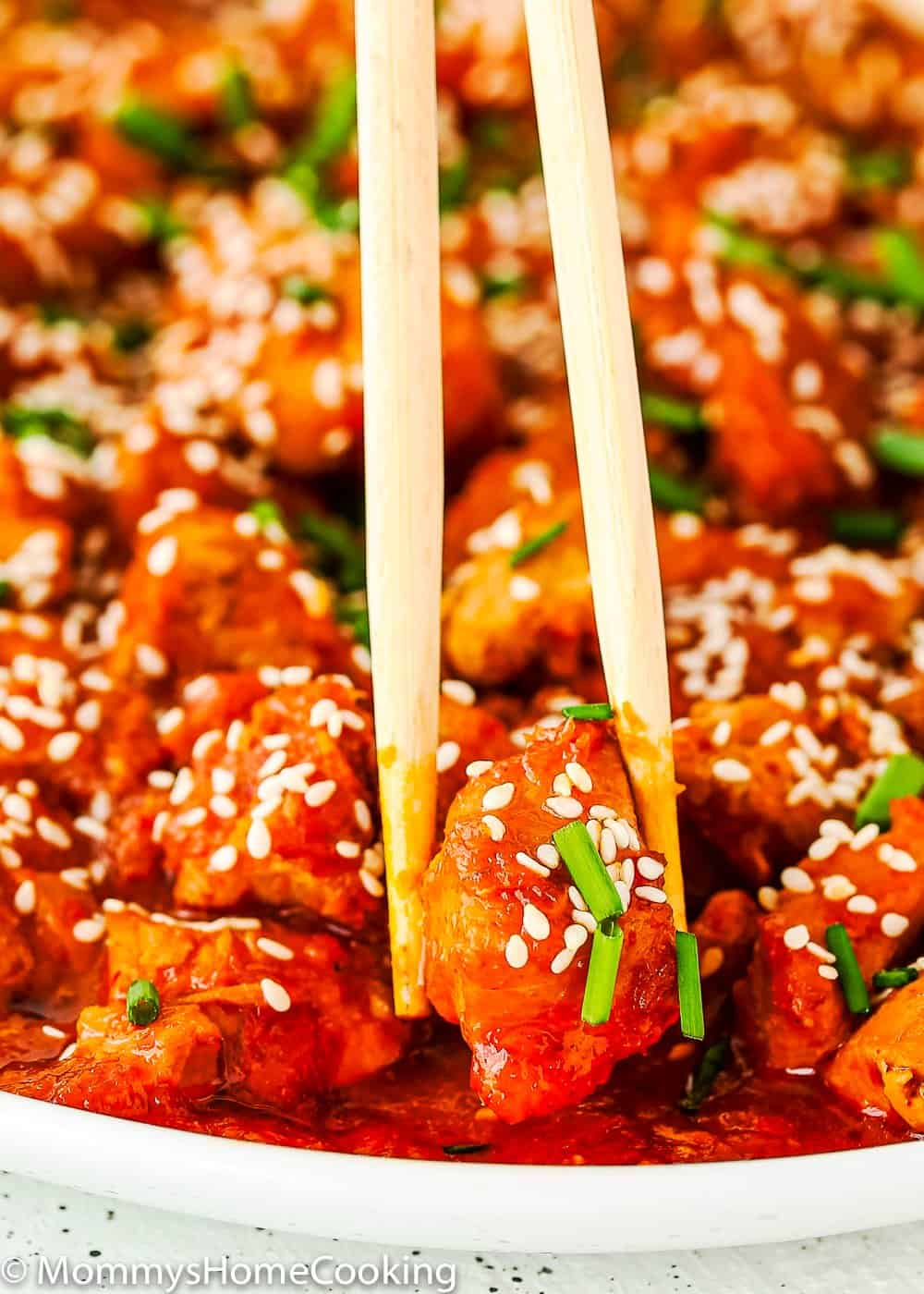 easy and tender Instant Pot Korean Kimchi Chicken and chopsticks