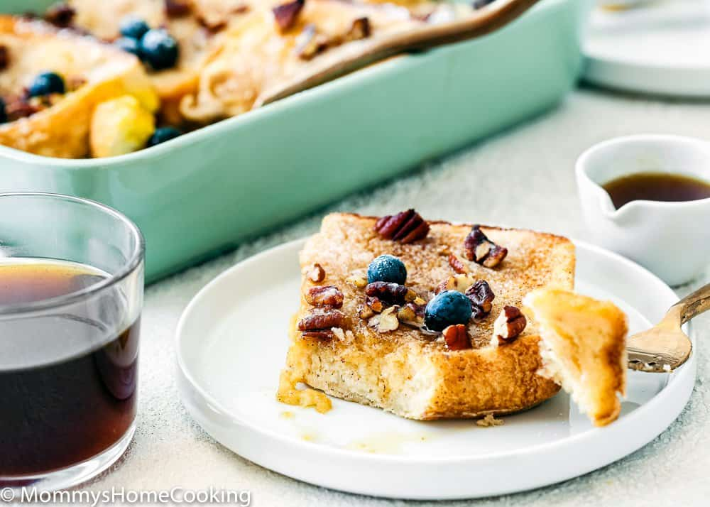 Eggless French Toast in a plate with nuts and blueberries