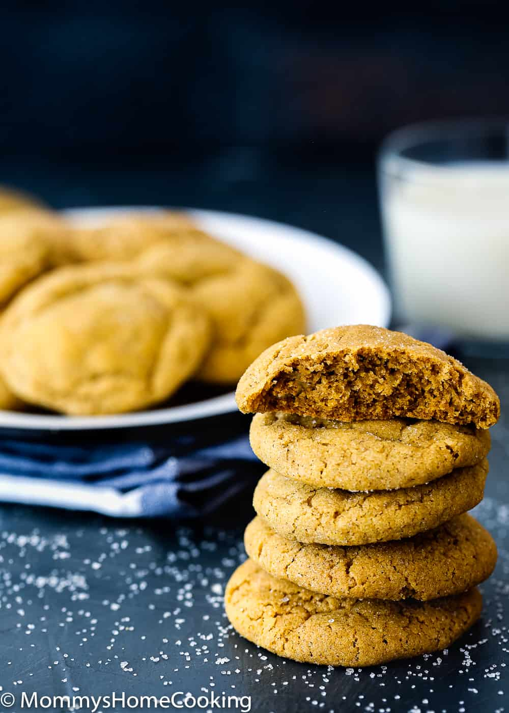 stack of Eggless Pumpkin Snickerdoodles cookies with a glass of milk