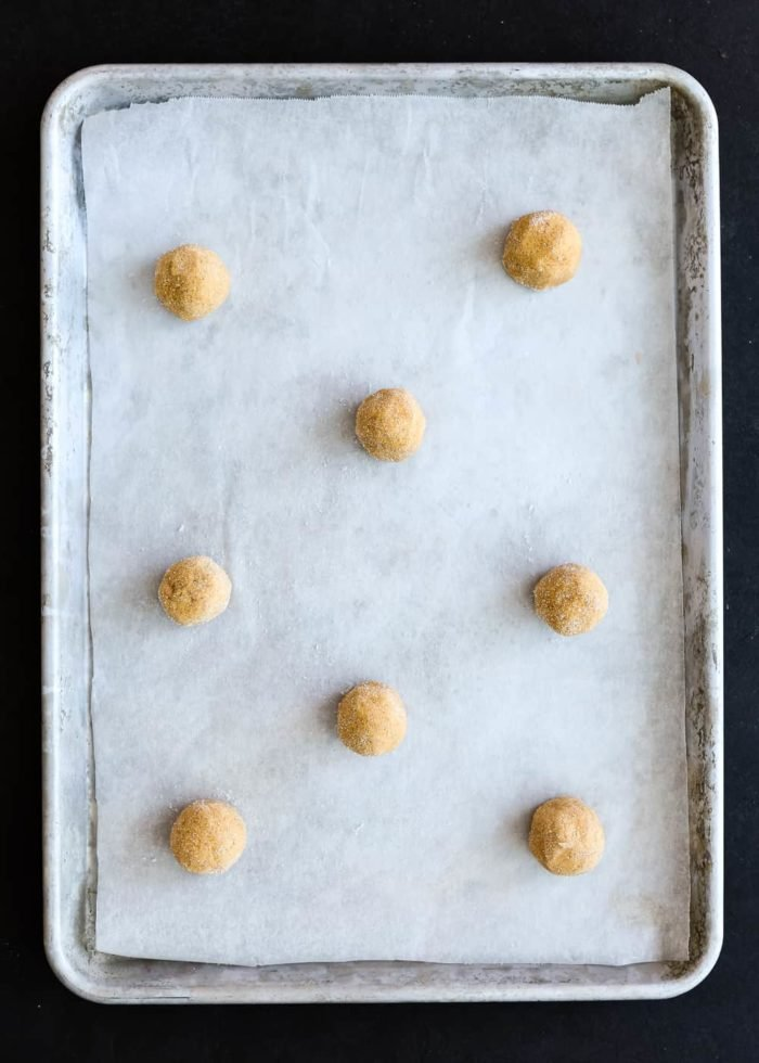 Eggless Pumpkin Snickerdoodles Dough balls in a cookie sheet