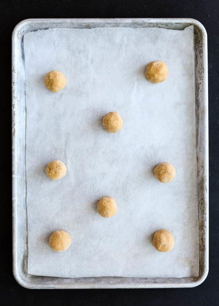 Eggless Pumpkin Snickerdoodles Dough balls in a cookie sheet