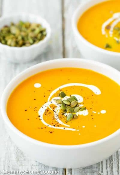 Easy Instant Pot Pumpkin Soup in a bowl with cream and roasted pumpkin seeds