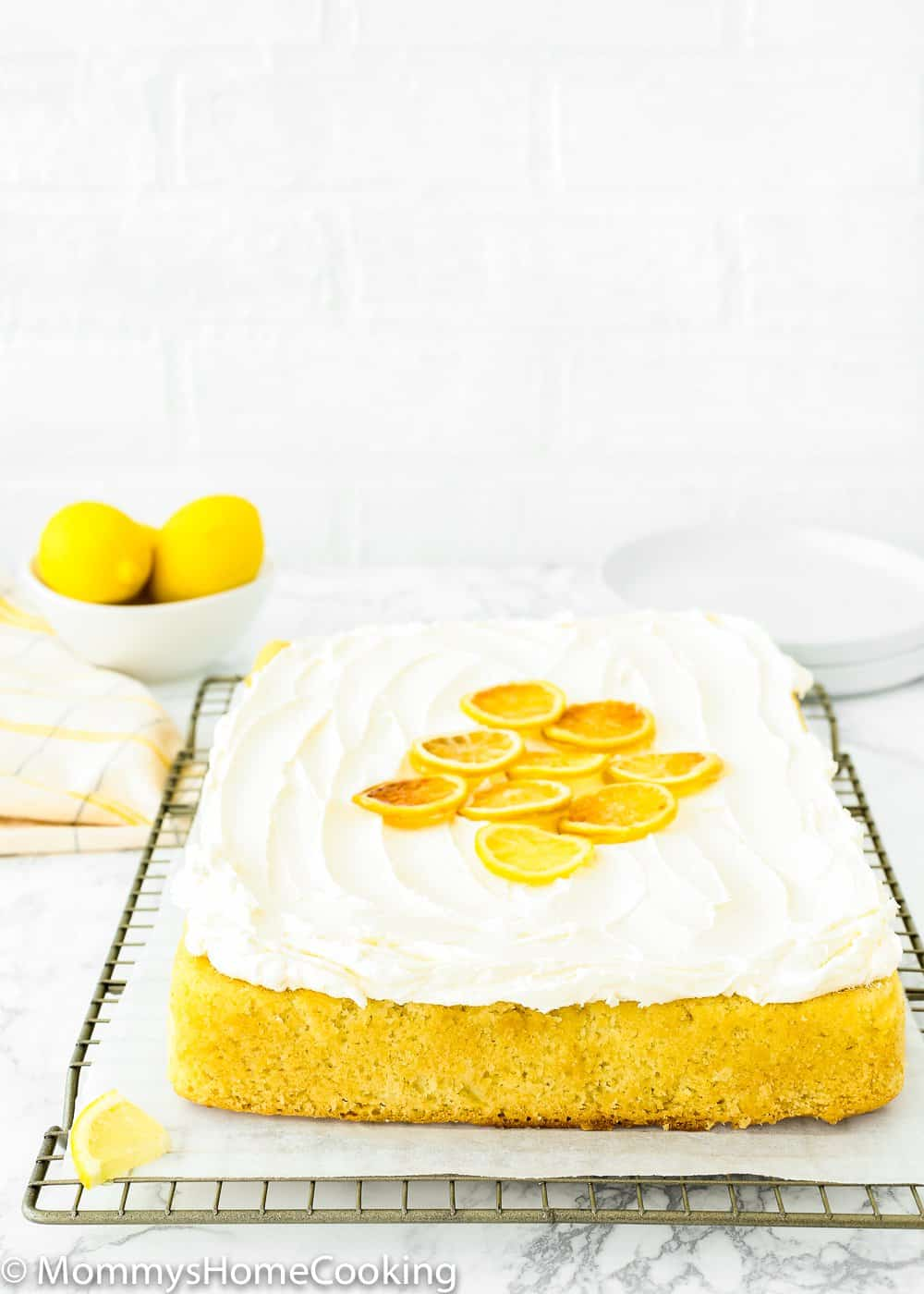 Eggless Lemon sheet pan cake over a cooling rack