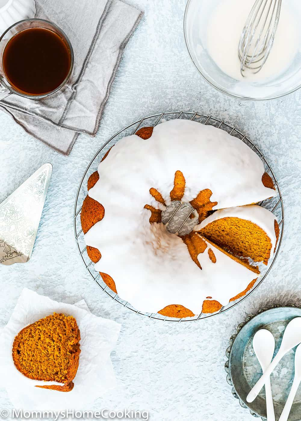 Glazed Eggless Pumpkin Cake over a cooling rack